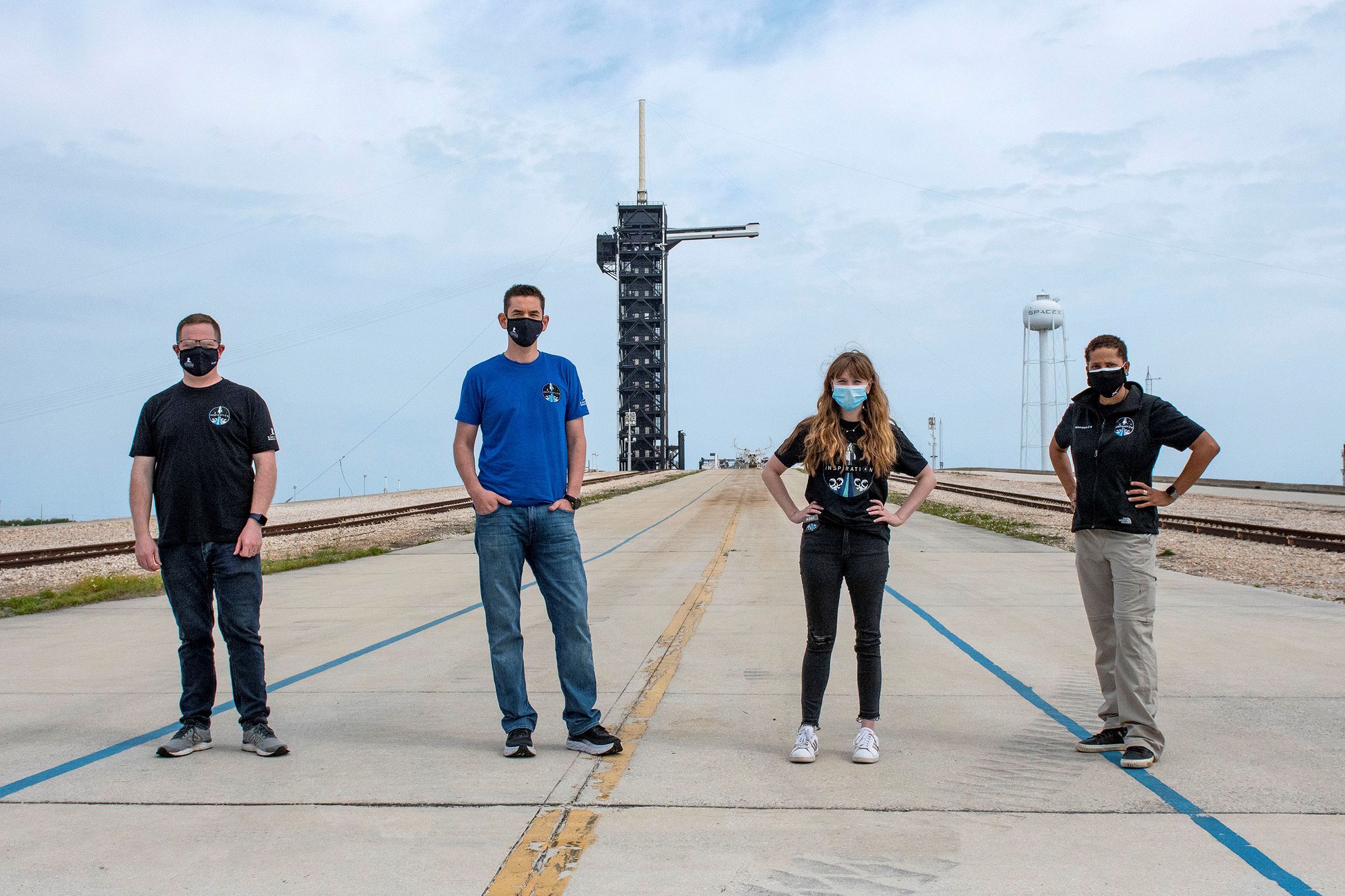 Chris Sembroski, Jared Isaacman, Hayley Arceneaux and Sian Proctor pose for a photo at NASA's Kennedy Space Center at Cape Canaveral, Florida, on March 29.