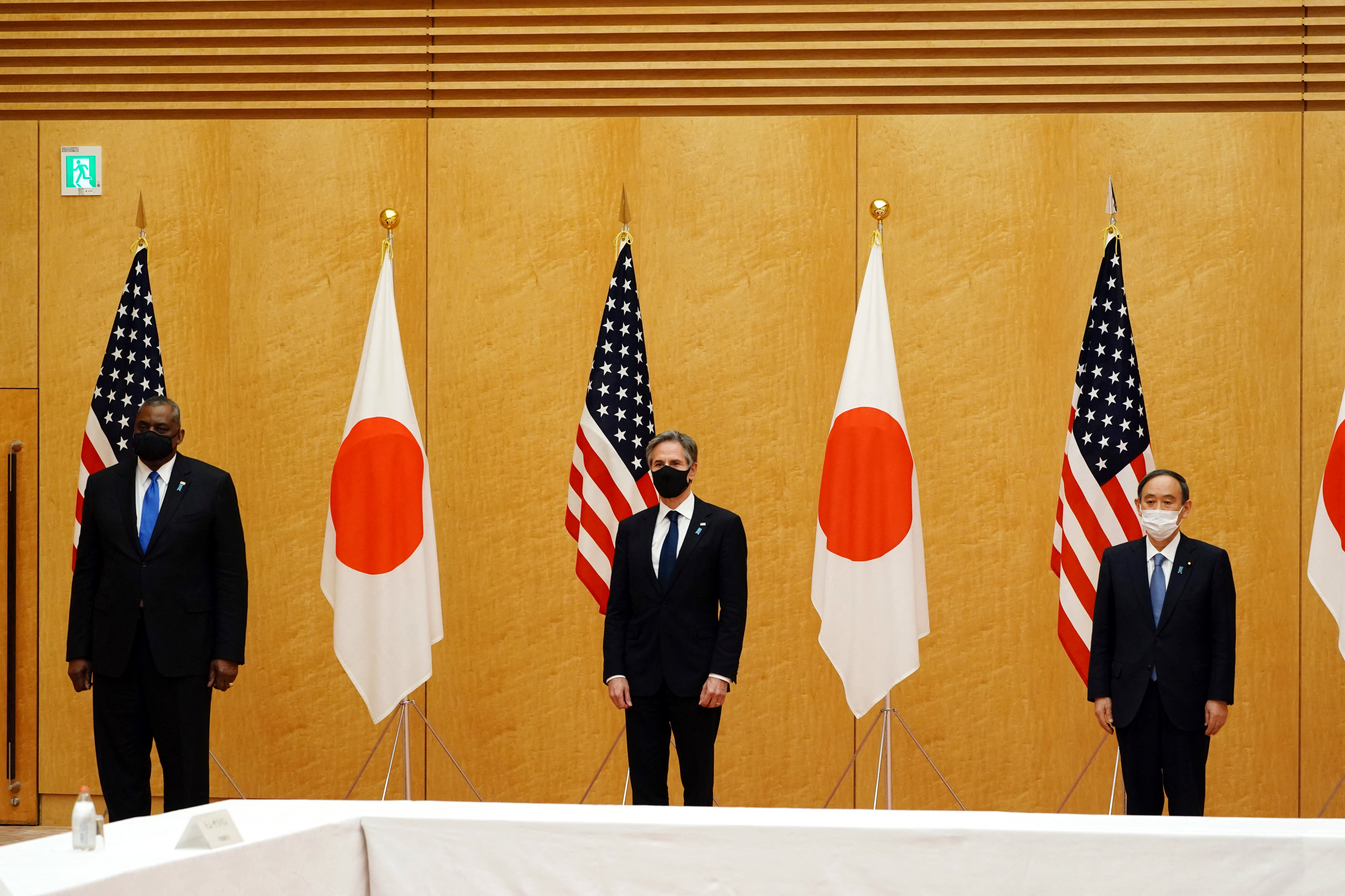 Japan's Prime Minister Yoshihide Suga (R) poses with U.S. Secretary of State Antony Blinken (C) and U.S. Defense Secretary Lloyd Austin (L) during a courtesy call at the prime minister's official residence in Tokyo on March 16, 2021.