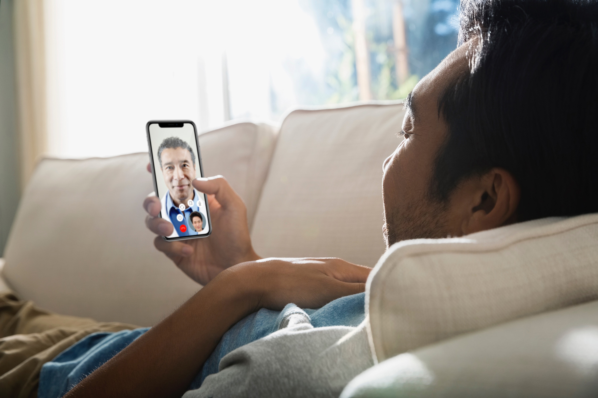 A patient visits with a doctor through the Teladoc app.