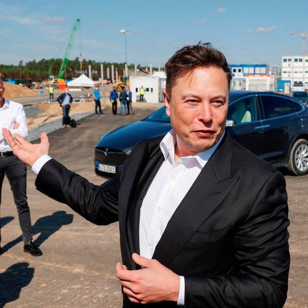Tesla CEO Elon Musk talks to media as he arrives at a construction site in September, 2020.