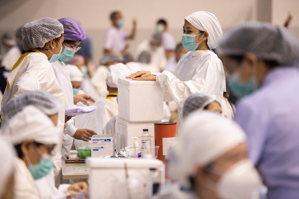 Health workers prepare to administer people with the CoronaVac vaccine developed by Sinovac firm inside a sport stadium in Phuket, Thailand on April 22, 2021.