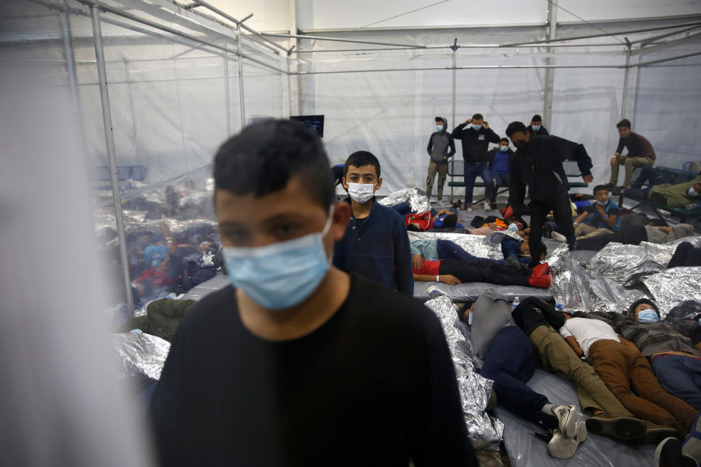 Young children are housed inside a pod at the Department of Homeland Security holding facility run by U.S. Customs and Border Protection on March 30, 2021 in Donna, Texas.