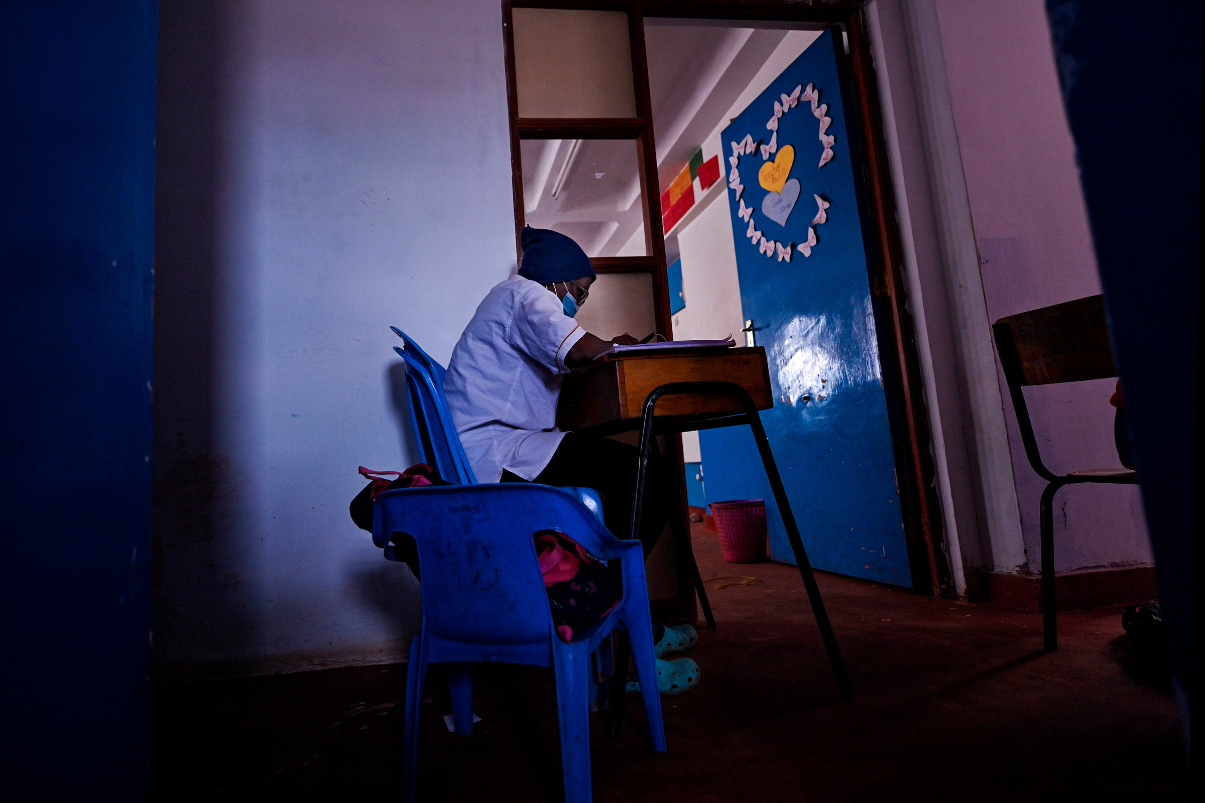 A student sits at her desk at Kibera School for Girls in Kibera, Nairobi, kenya, on Aug. 7, 2020.