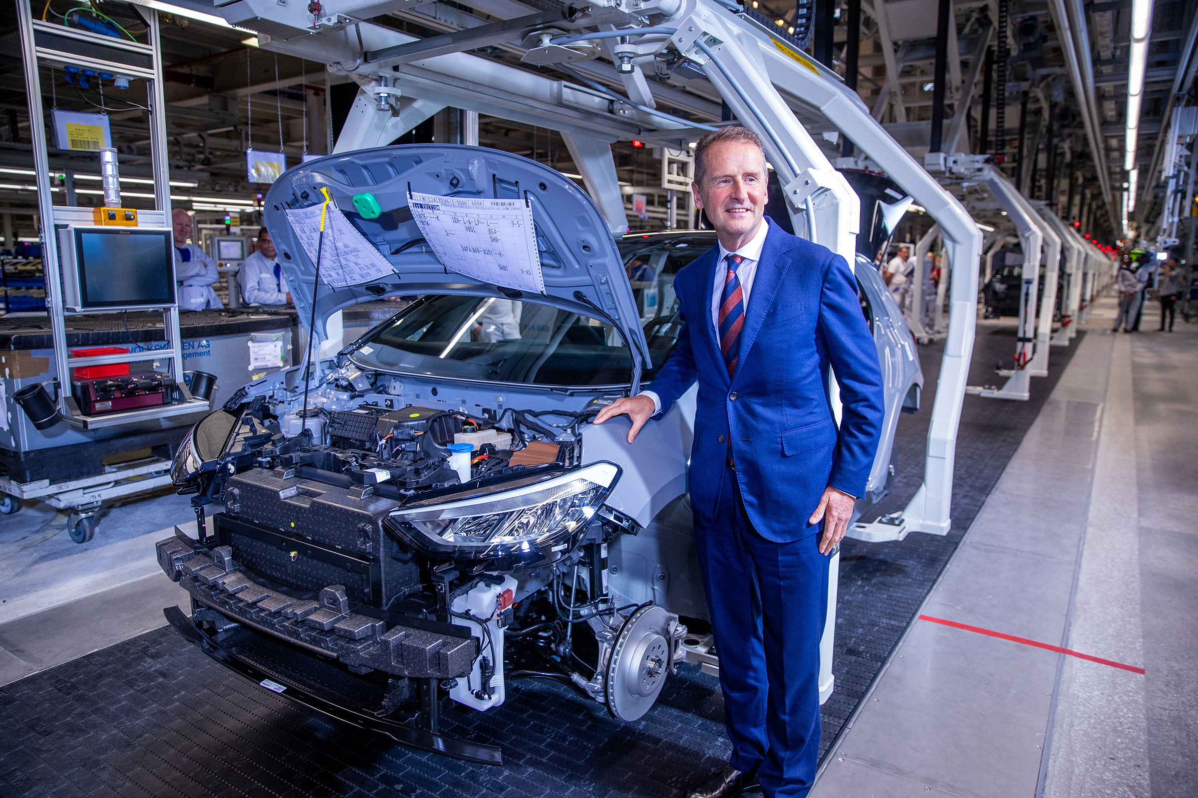 Herbert Diess, Volkswagen Group CEO, stands beside the assembly line for the production of the ID.3 electric car.