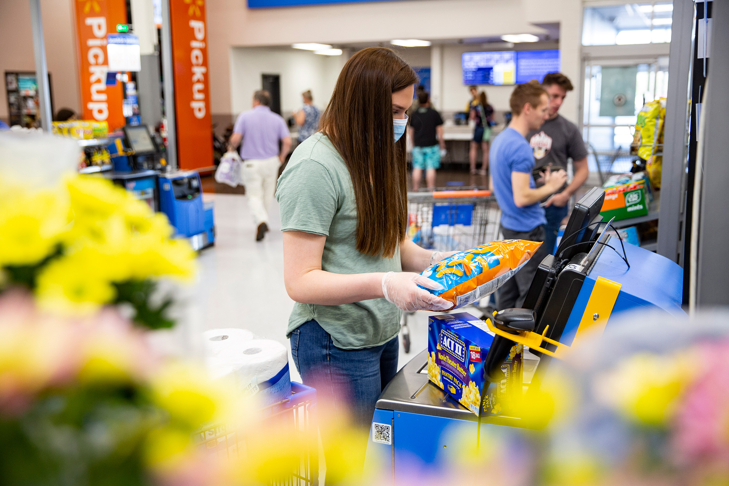 A customer uses self-checkout in a Walmart store in 2020.