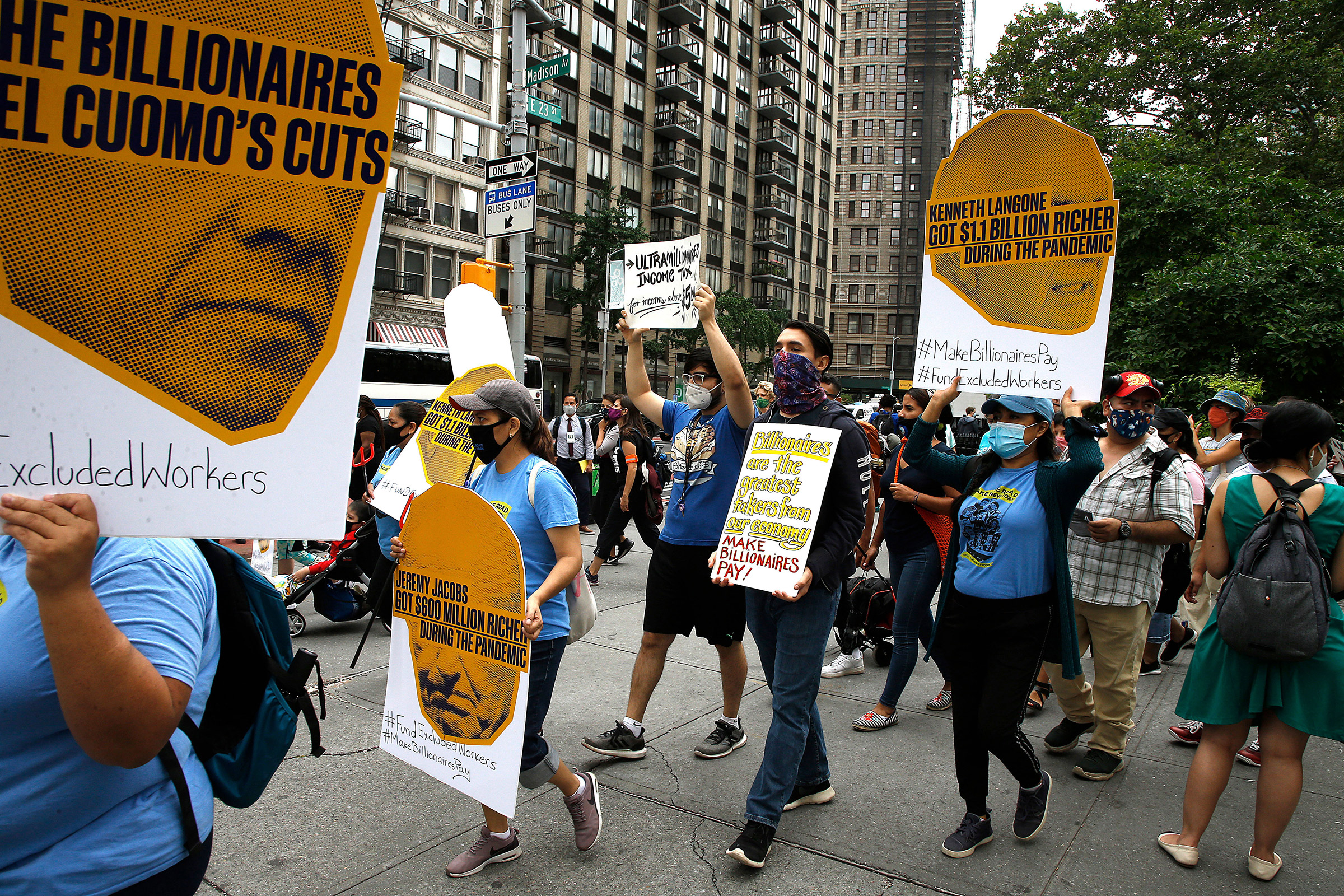 """People demonstrate during the """"March on Billionaires"""" to raise attention to the inequity in income among the wealthy and the working class in New York City on July 17, 2020."""