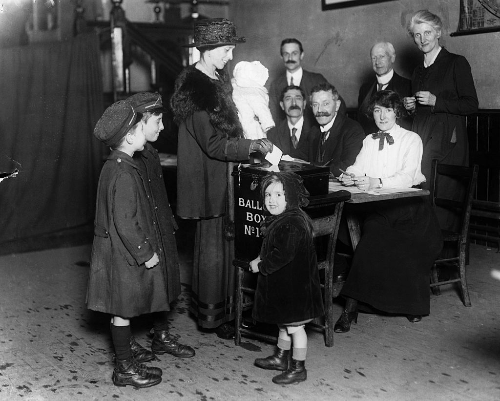 A woman votes in 1918