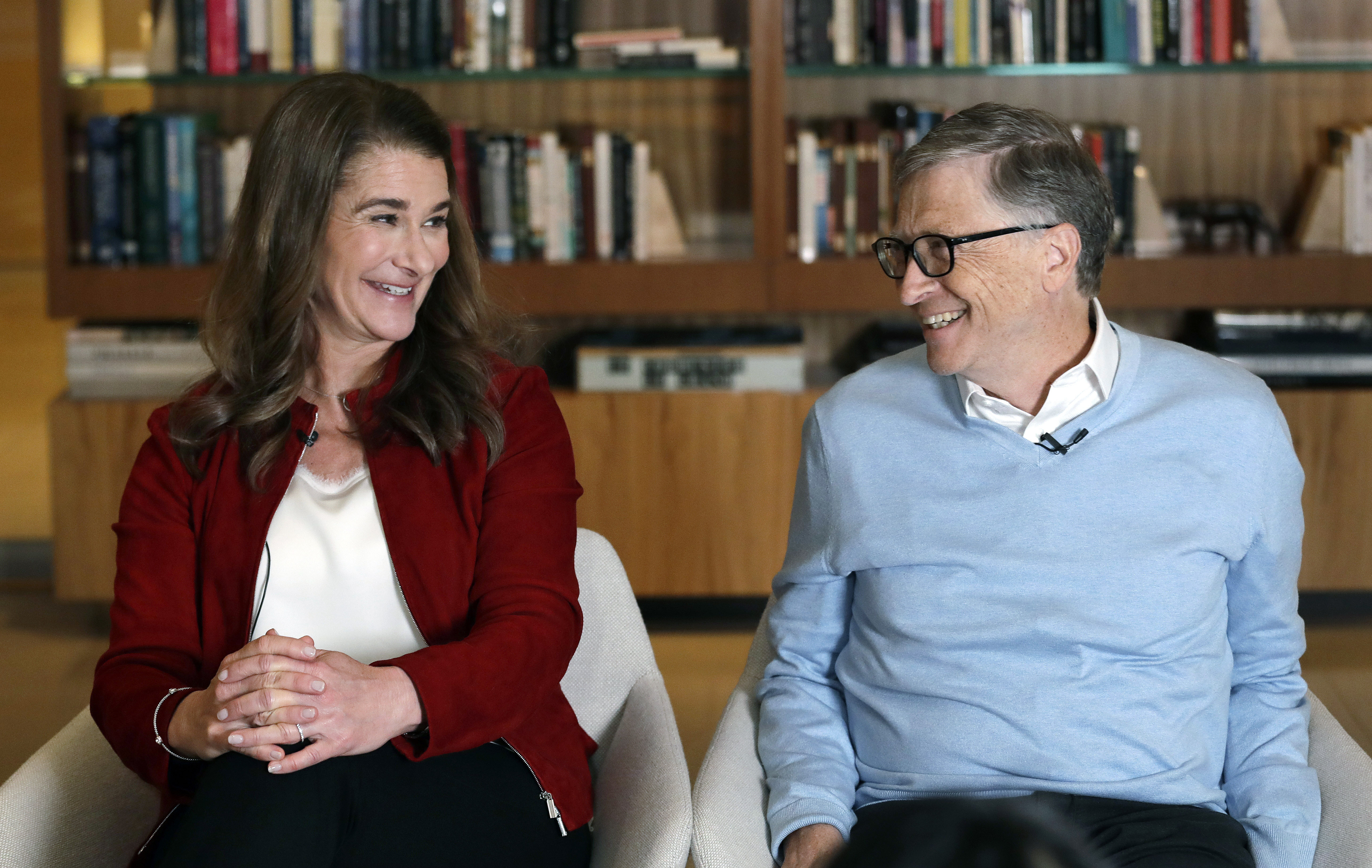 Bill and Melinda Gates smile at each other during an interview in Kirkland, Wash., on Feb. 1 2019.