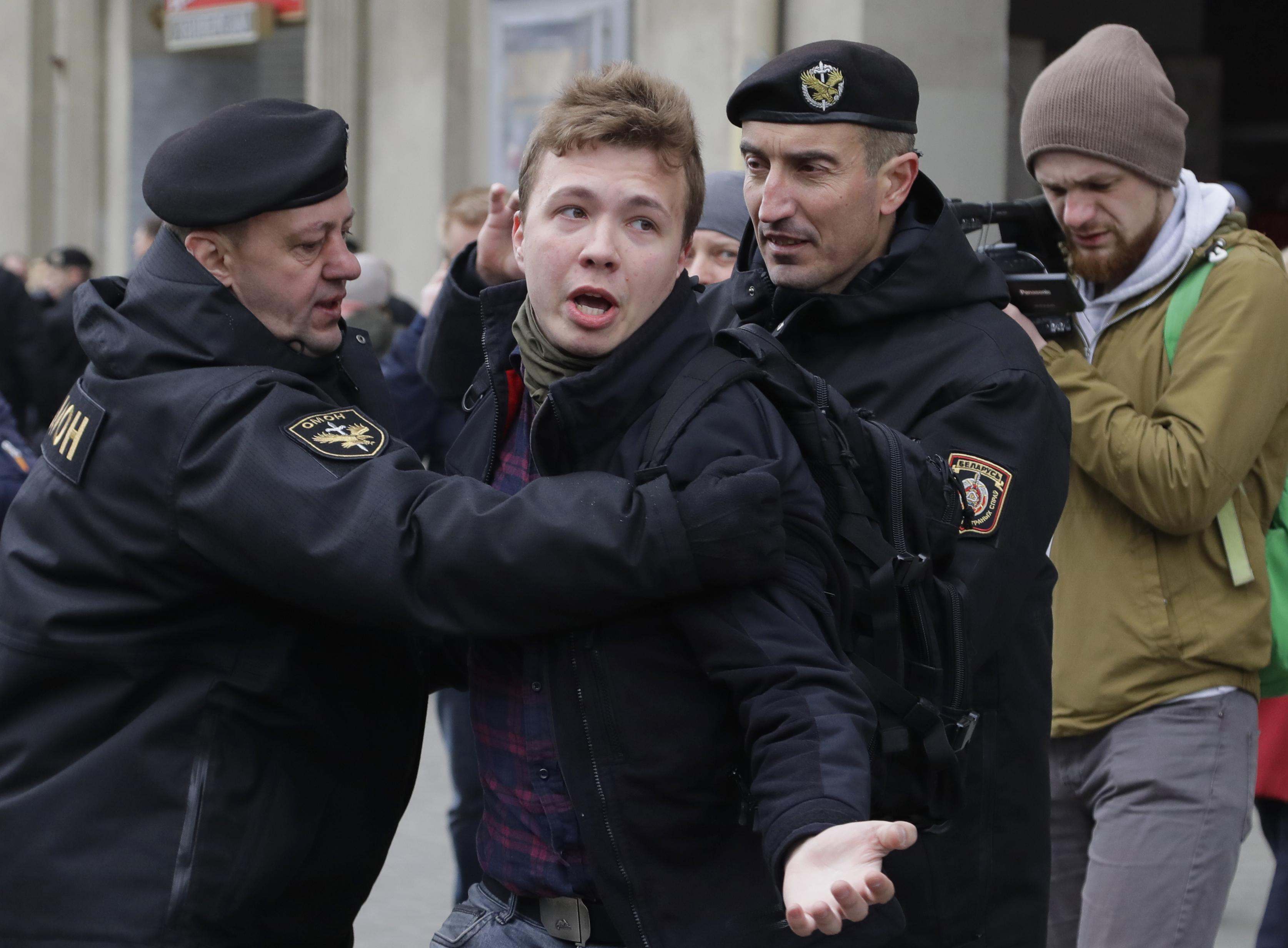Belarus police detain journalist Raman Pratasevich, center, in Minsk, Belarus, on March 26, 2017.