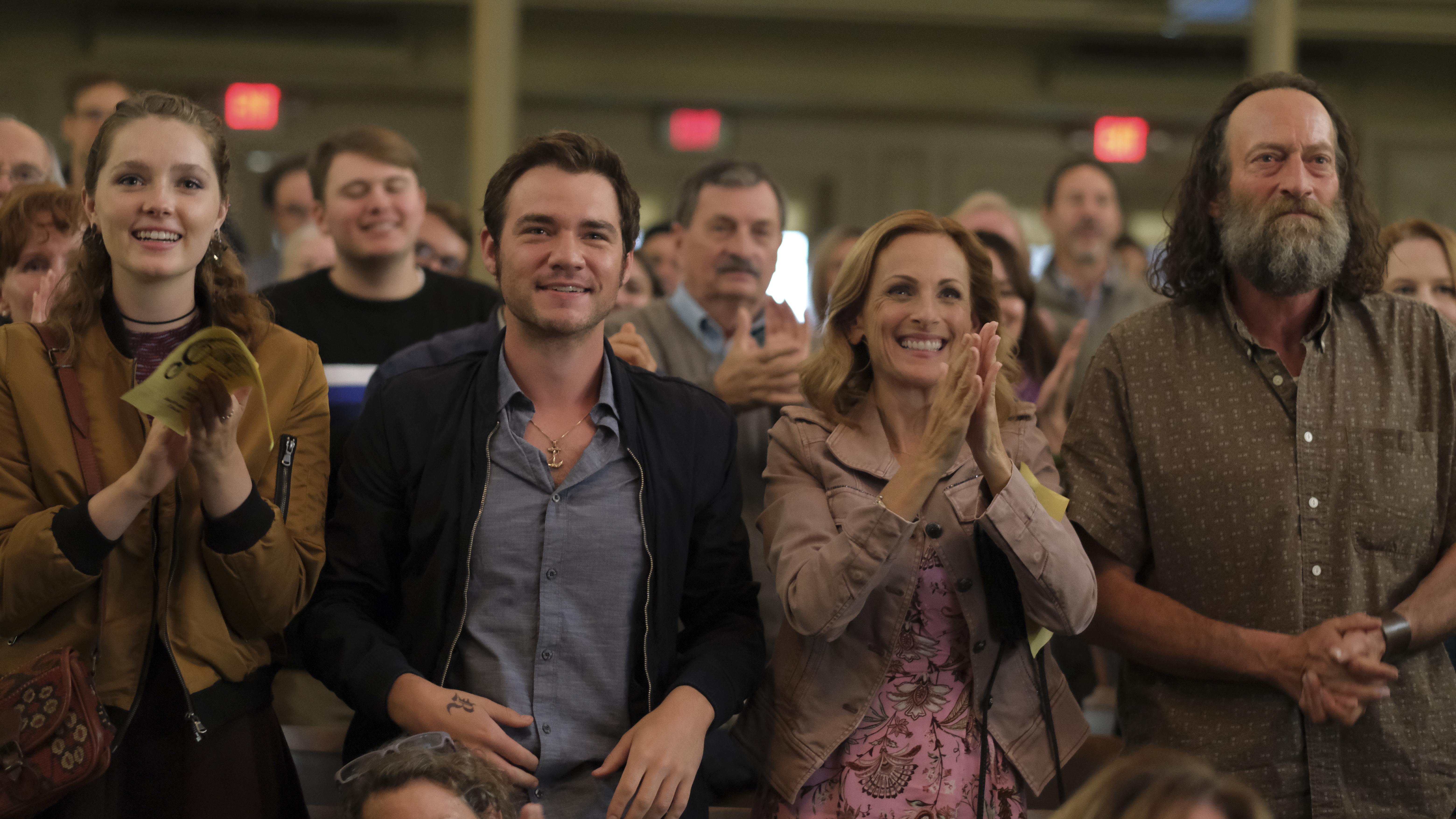 Marlee Matlin, second from right, plays the deaf mother of a hearing child in this family drama
