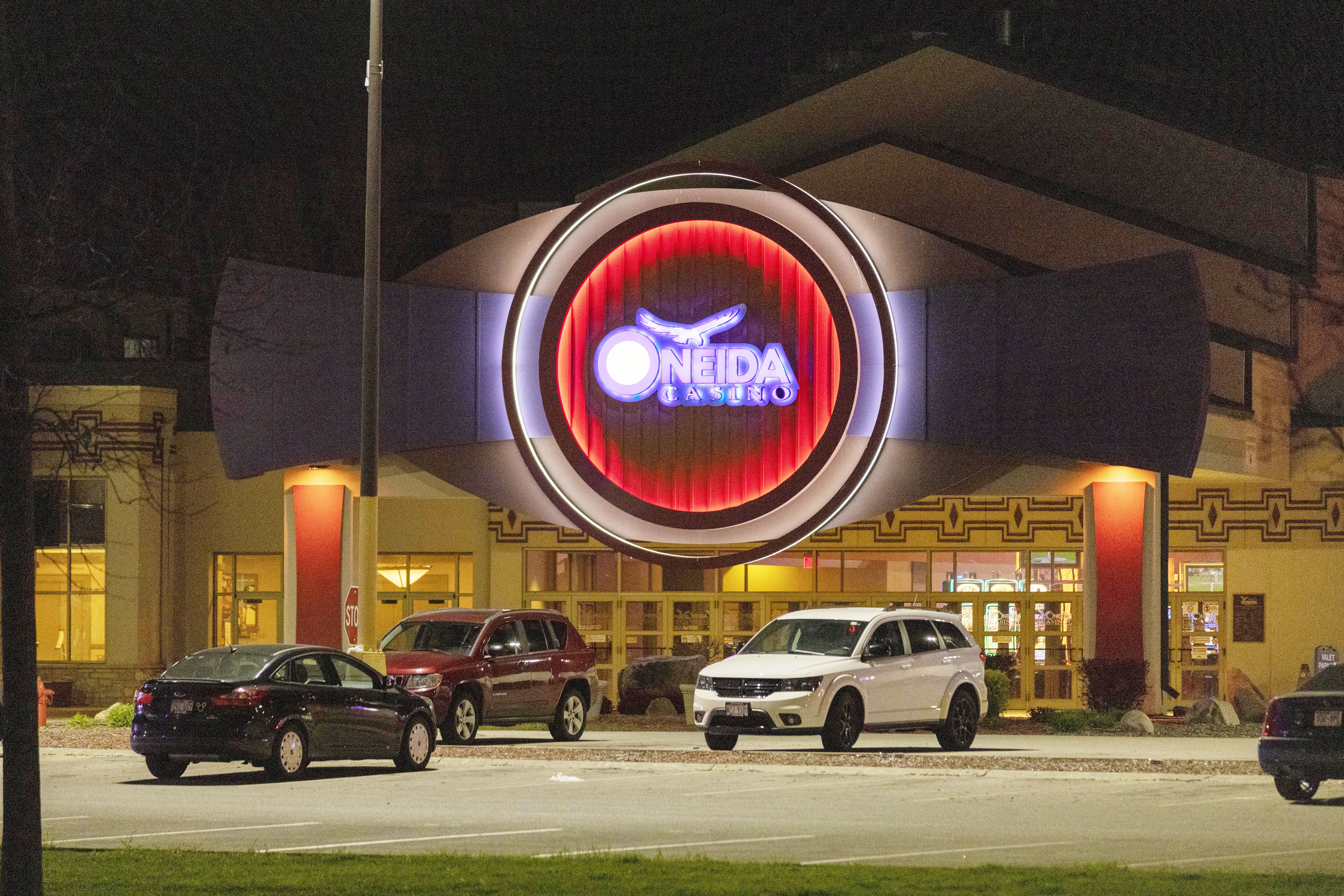 The Oneida Casino lights glow in the parking lot near Green Bay on May 2, 2021.