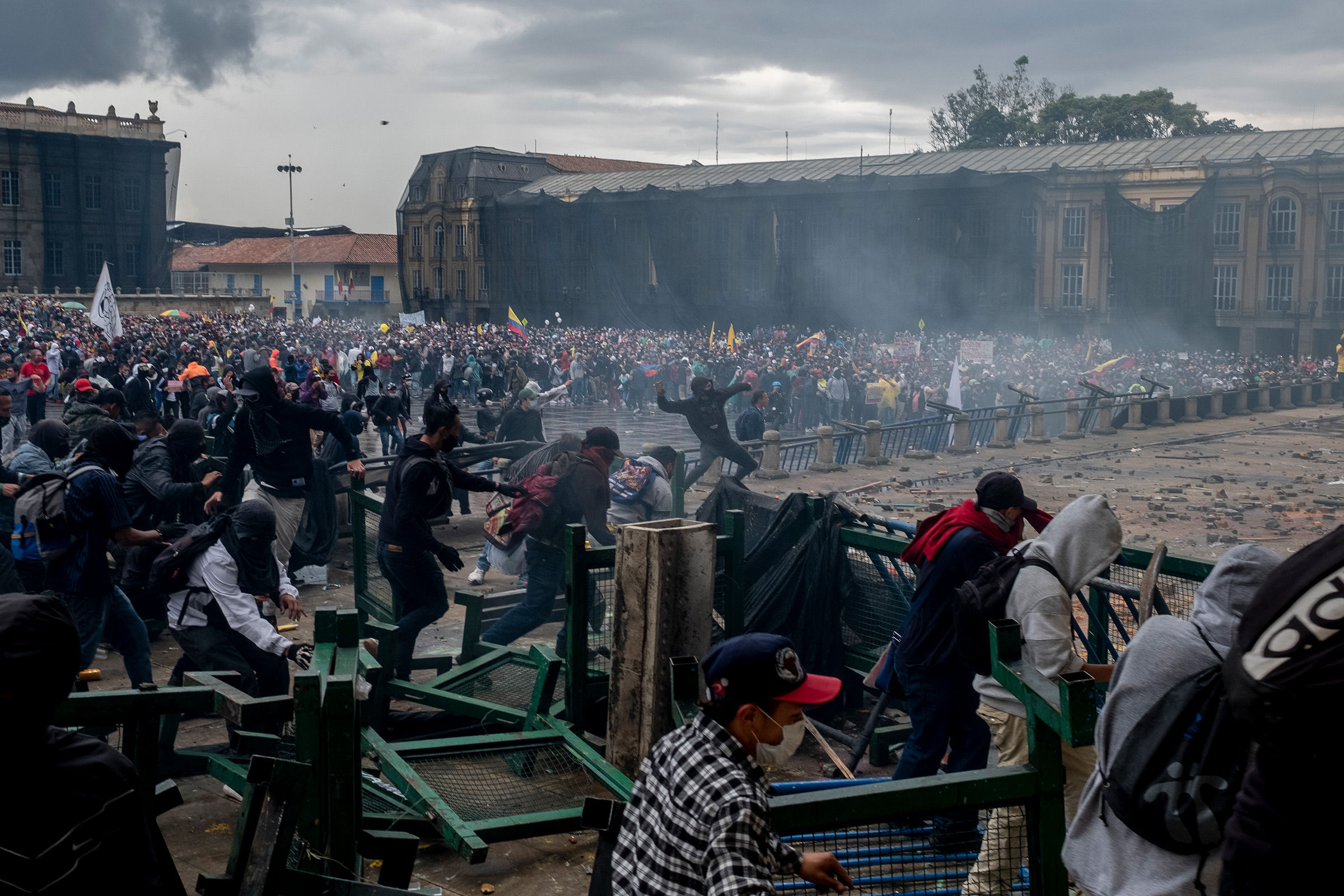 Protesters run up against barricades in Bogotá on April 28.