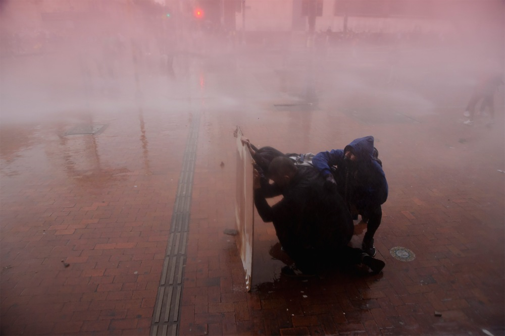 Bogota May 05- Esmad's armored vehicles fire their water cannon to disperse the protesters- Paula thomas