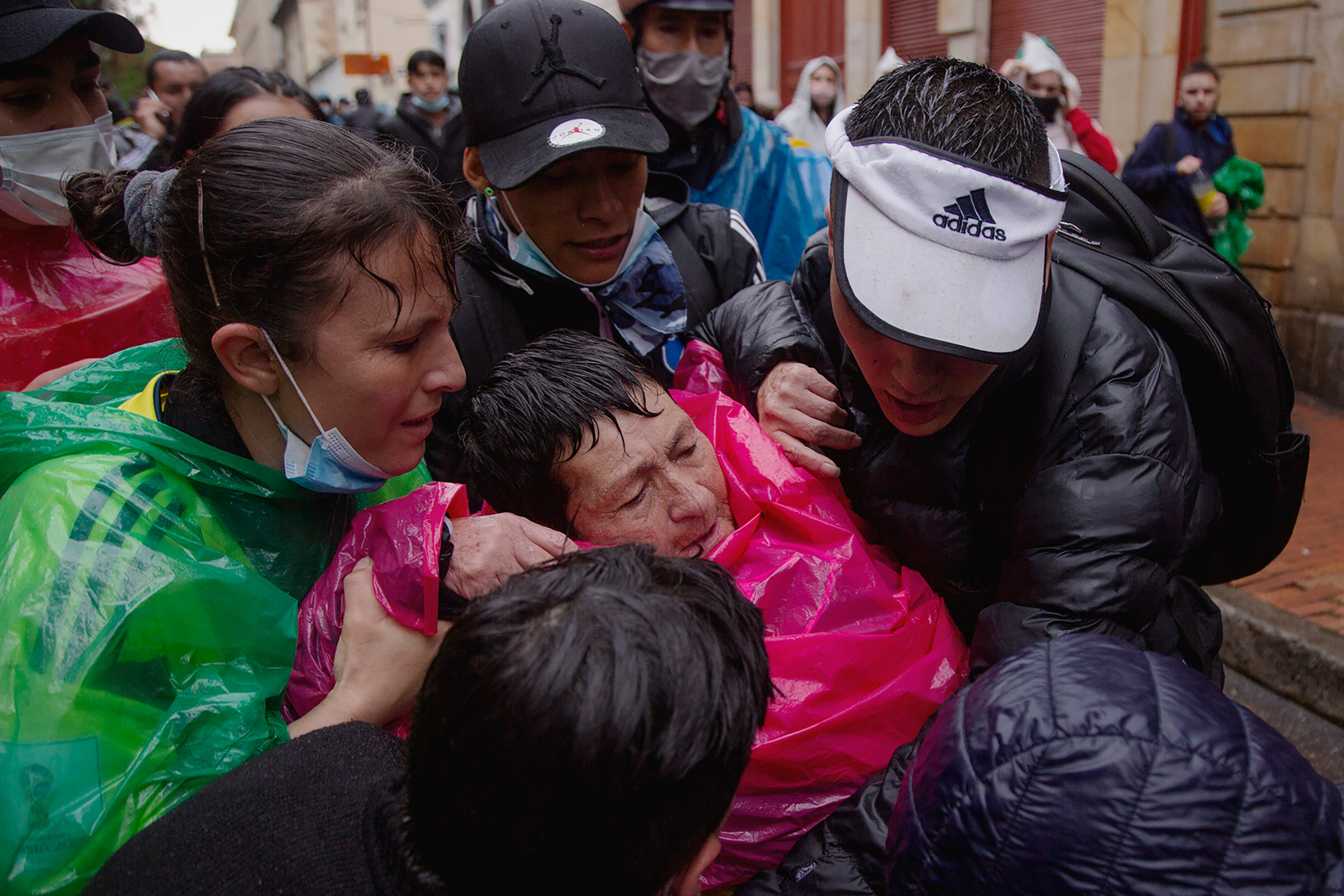 An elderly woman receives first aid treatment after exposure to tear gas used by riot police in Bogotá on May 5.