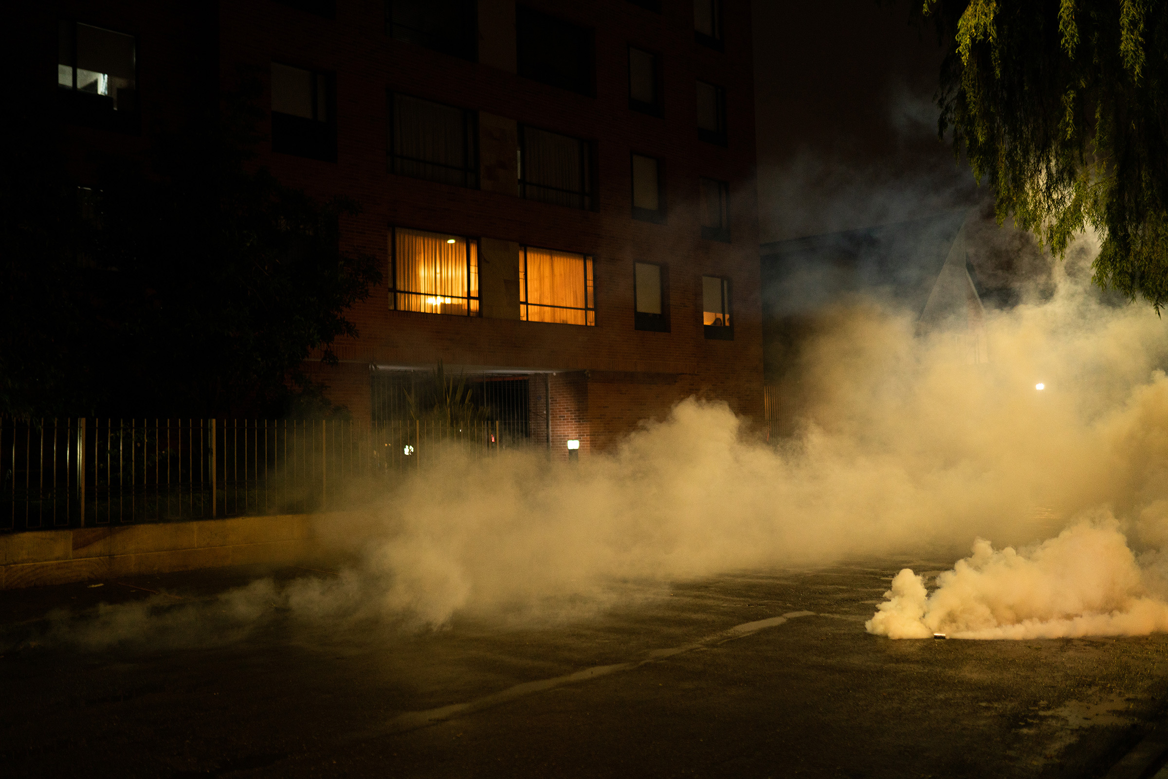 Tear gas on the streets of Bogotá on May 1. From April 28 to May 6, there have been over 100 cases of gunfire used against protesters, according to civil society groups.