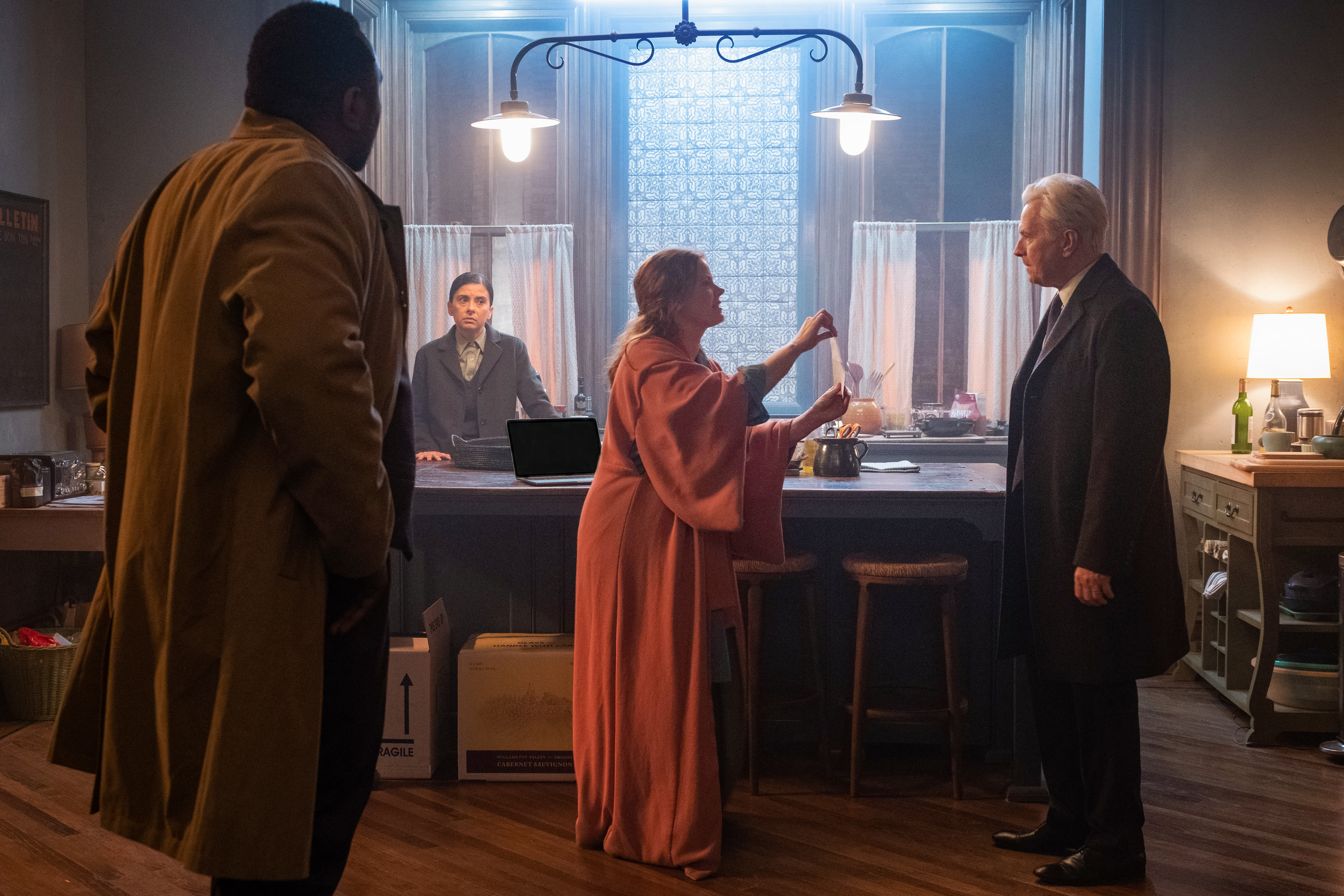 Two detectives (Brian Tyree Henry and Jeanine Serralles) look on as Amy Adams' Anna argues with her neighbor (Gary Oldman)