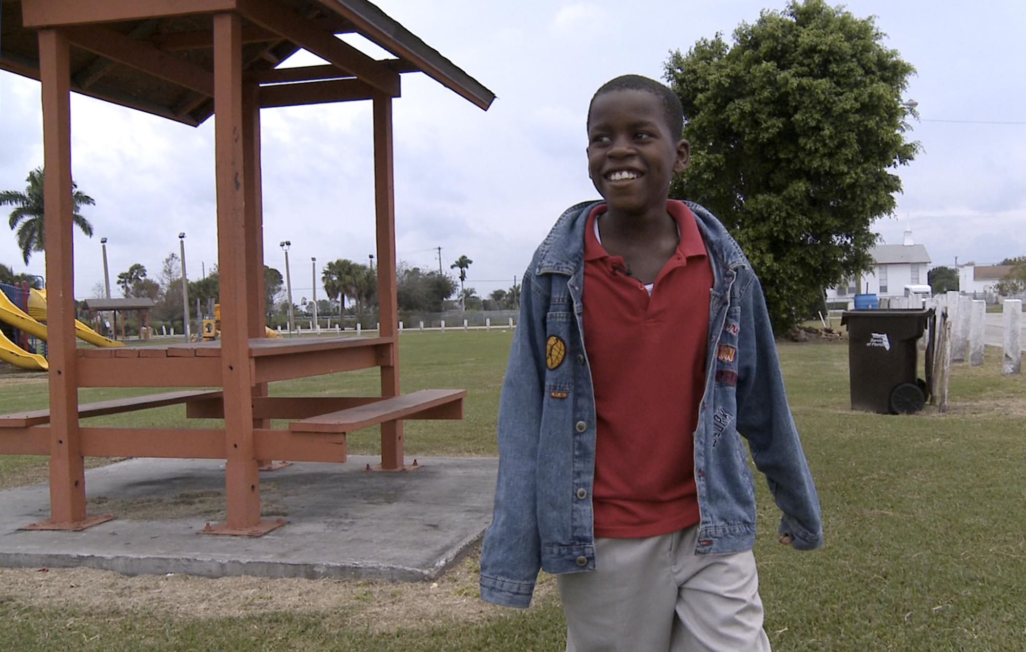 Damon Weaver, 10, walks in a park near his home in Pahokee, Fla, on Jan. 13, 2009.