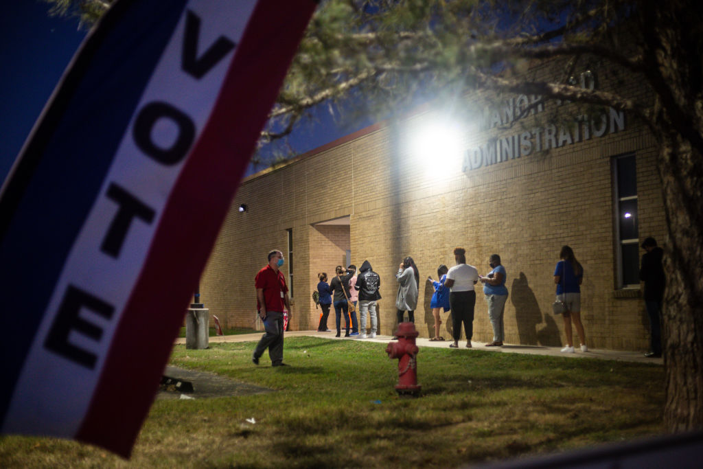 With an hour left to vote, people wait in line at Manor ISD Administration building in Manor, Texas, on November 3, 2020