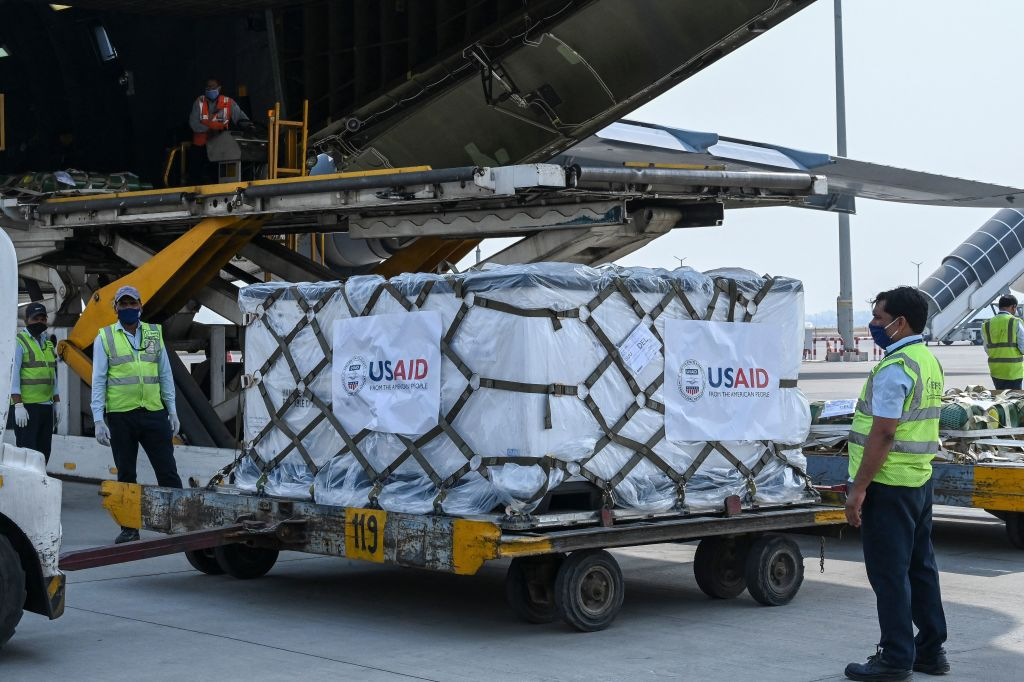 Ground staff unload Covid-19 coronavirus relief supplies from the US at the Indira Gandhi International Airport cargo terminal in New Delhi on April 30, 2021.