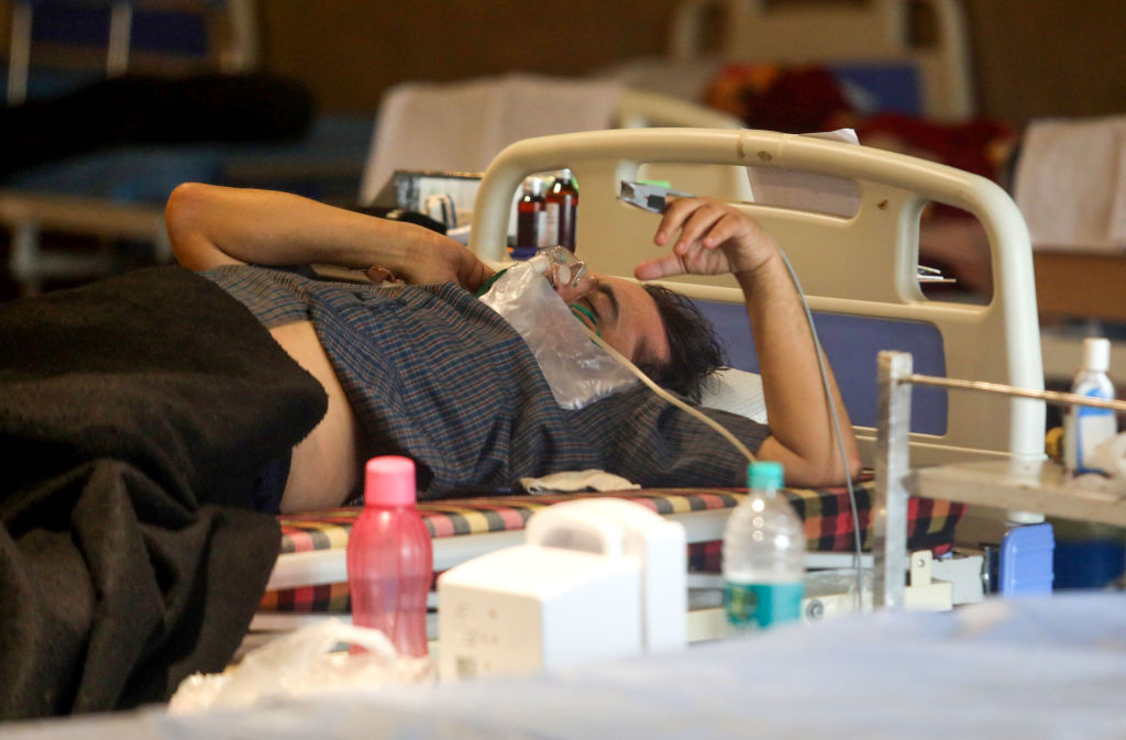 A patient wearing an oxygen mask inside a Covid-19 care center in New Delhi, India, on May 11, 2021.