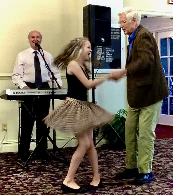 The author's father, Joe Schrobsdorff dancing with his granddaughter at an assisted-.living residence