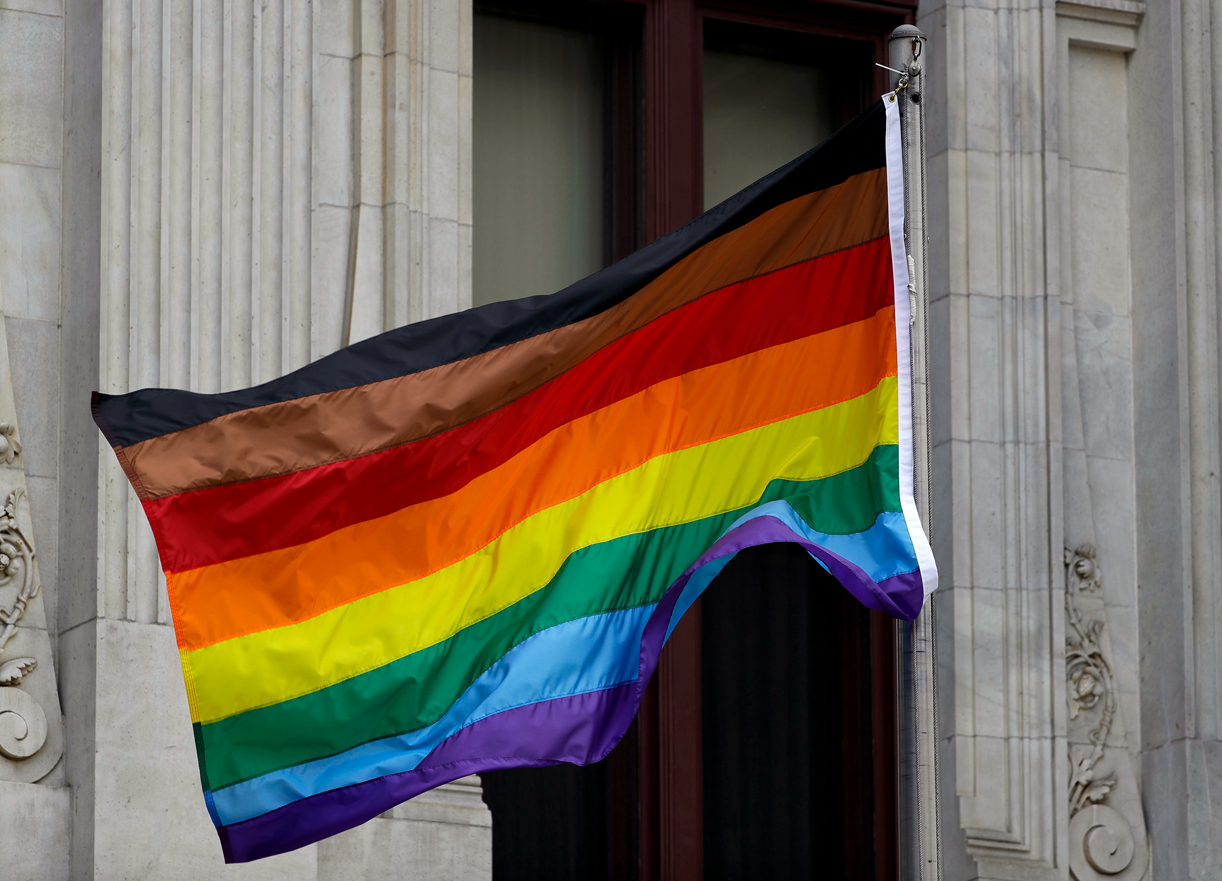 An altered gay pride flag seen outside City Hall in Philadelphia.