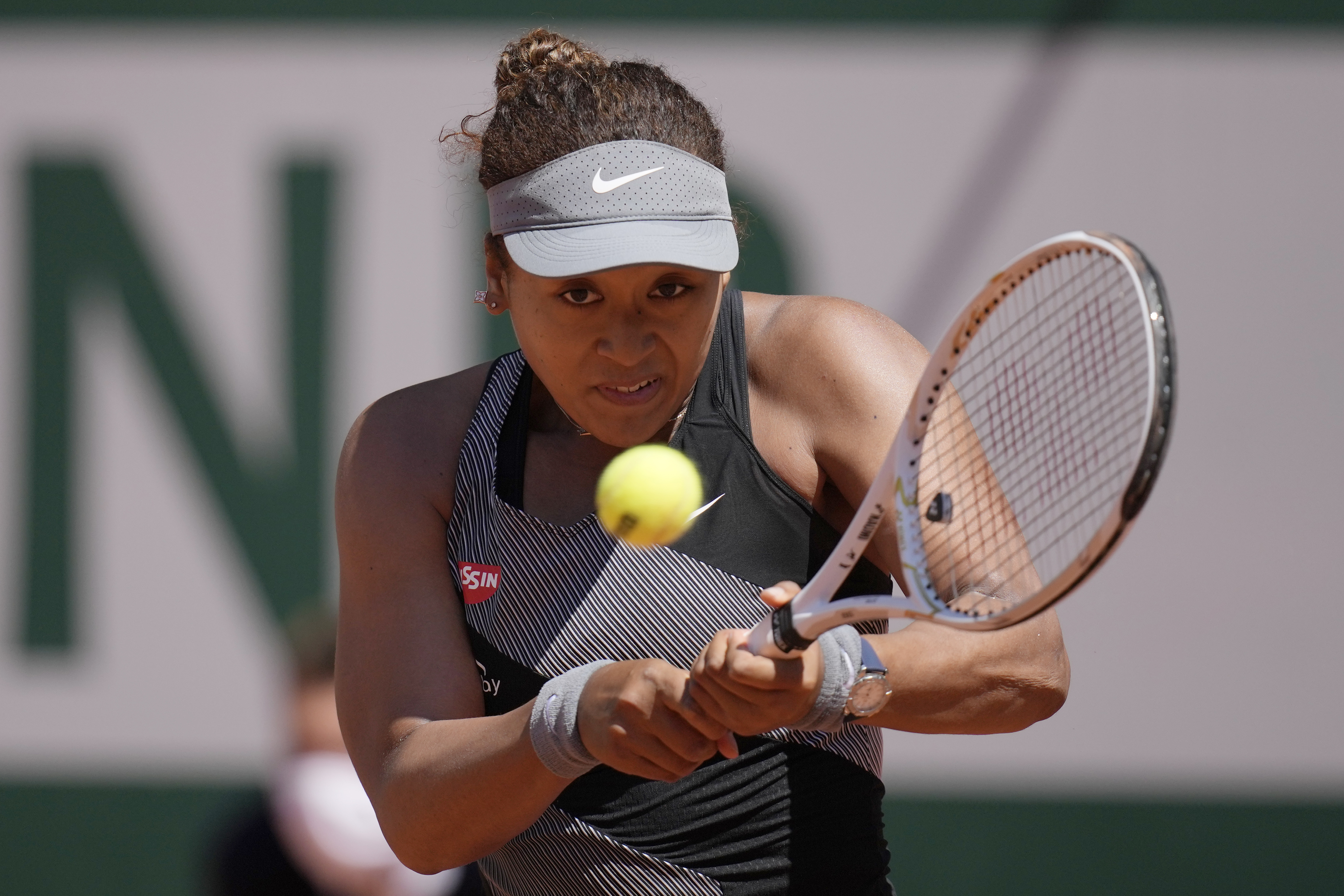 Japan's Naomi Osaka returns the ball to Romania's Patricia Maria Tig during their first round match of the French open tennis tournament at the Roland Garros stadium, in Paris, France, on May 30, 2021.