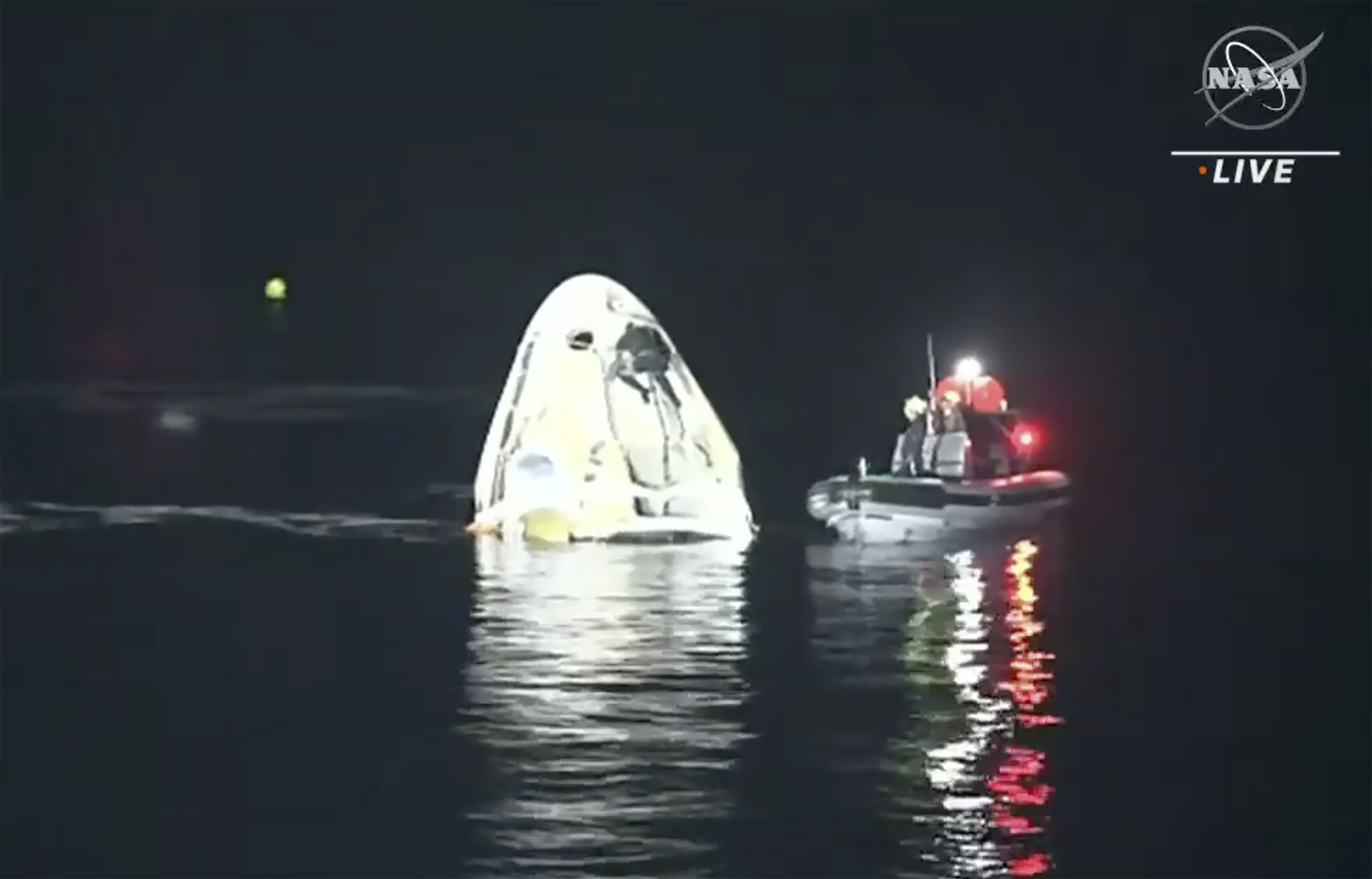 In this image made from NASA TV video, the SpaceX Dragon capsule floats after landing in the Gulf of Mexico near the Florida Panhandle early on May 2, 2021.