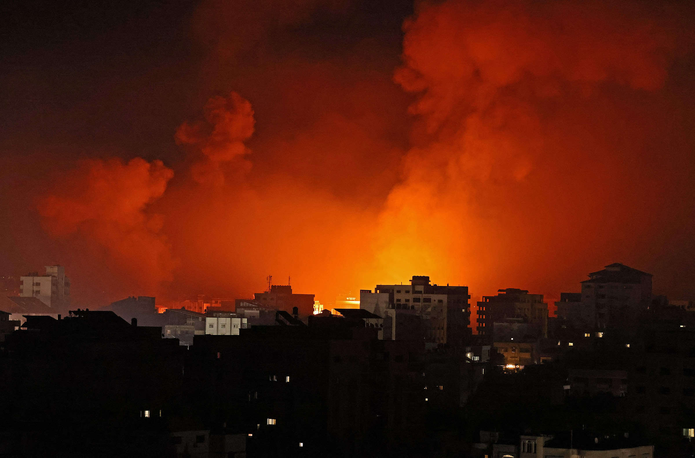 Smoke billows from a fire following Israeli airstrikes on multiple targets in Gaza City early on May 16.