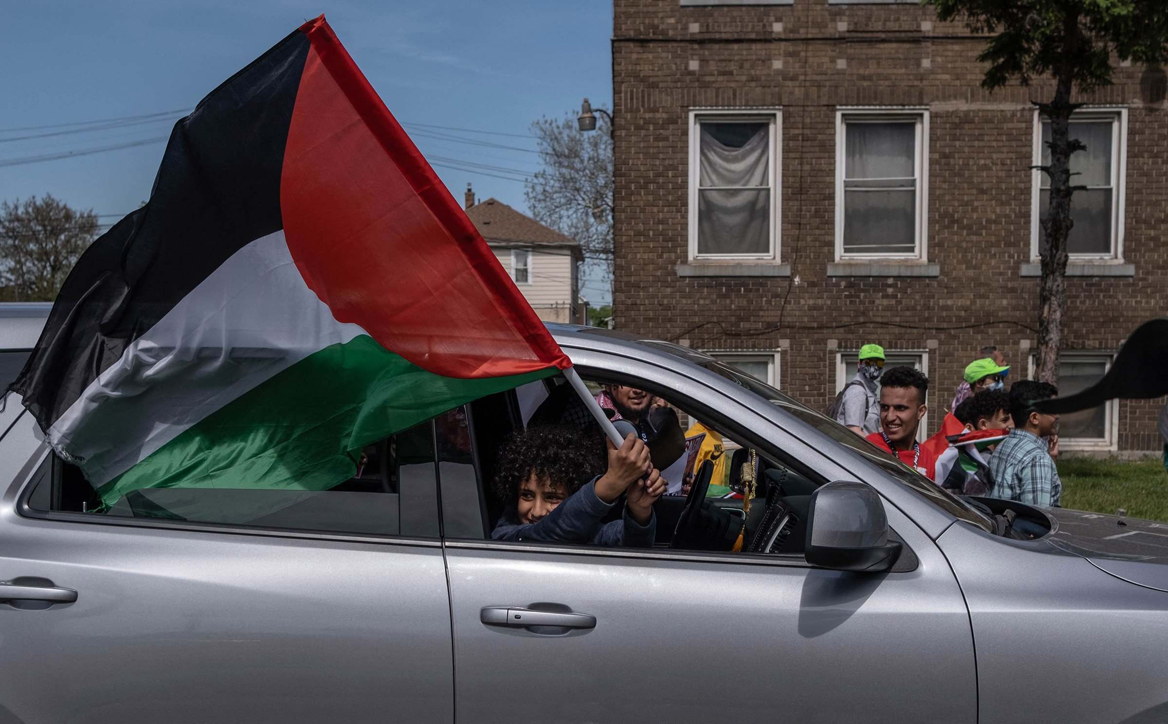 A protester waves a Palestinian flag during a march through neighborhoods near a Ford plant where U.S. President Joe Biden was touring in Dearborn, Mich., on May 18.