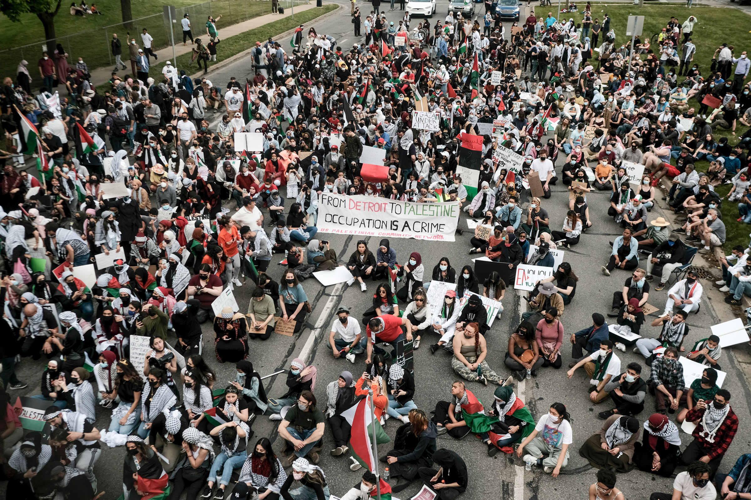 Protesters listen to speeches during a Free Palestine rally in Dearborn, Mich., on May 15, 2021.