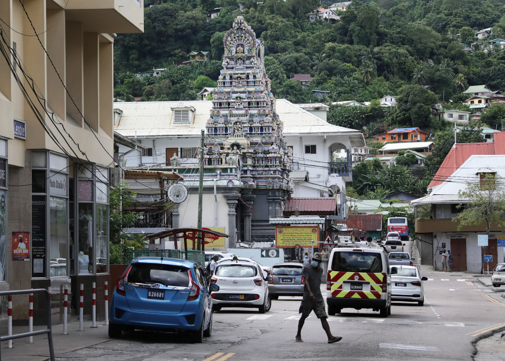 A man crosses a street in Victoria, the capital of the Seychelles in April 2021. The tiny Indian Ocean archipelago is seeing a spike in COVID-19 cases, despite having the highest percentage of people with two doses of vaccine of any country in the world.