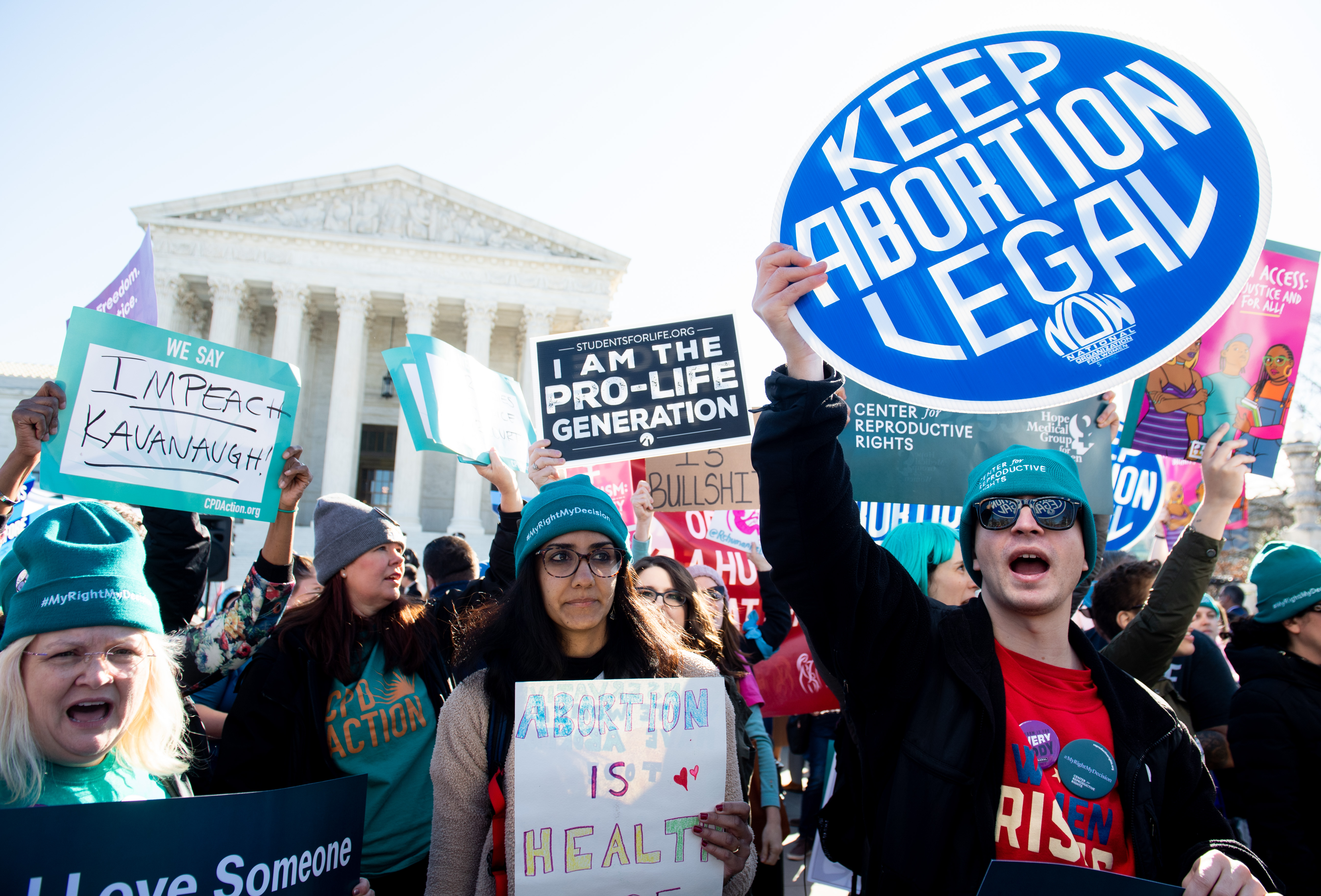 Abortion rights activists and those opposing abortion protest during a demonstration outside the U.S. Supreme Court in Washington, D.C., March 4, 2020, during oral arguments regarding a Louisiana law about abortion access.