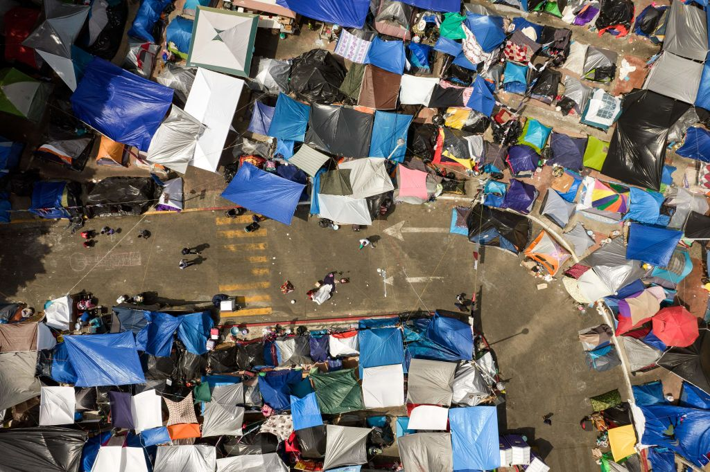 Aerial view of an improvised migrants and asylum seekers camp outside El Chaparral crossing port as they wait for U.S. authorities to allow them to start their migration process in Tijuana on May 9, 2021.