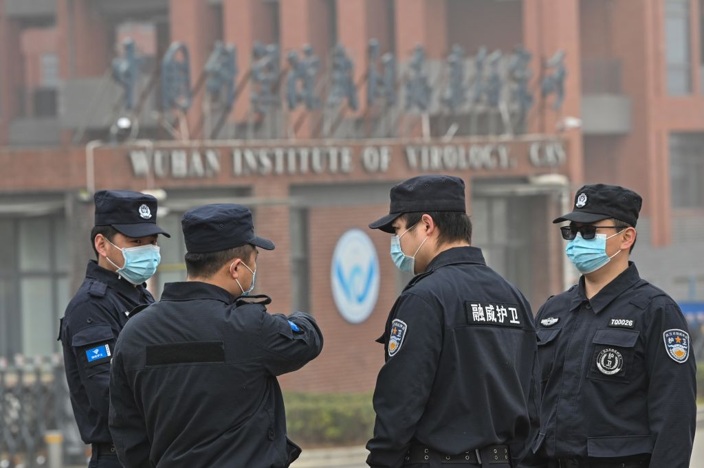 Security personnel stand guard outside the Wuhan Institute of Virology in Wuhan as members of the World Health Organization (WHO) team investigating the origins of the COVID-19 coronavirus make a visit to the institute in Wuhan in China's central Hubei province on Feb. 3, 2021.