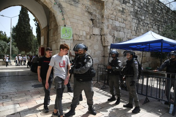 Israeli police detain some Palestinians during their intervention at the Al-Aqsa Mosque in East Jerusalem on May 21, 2021.