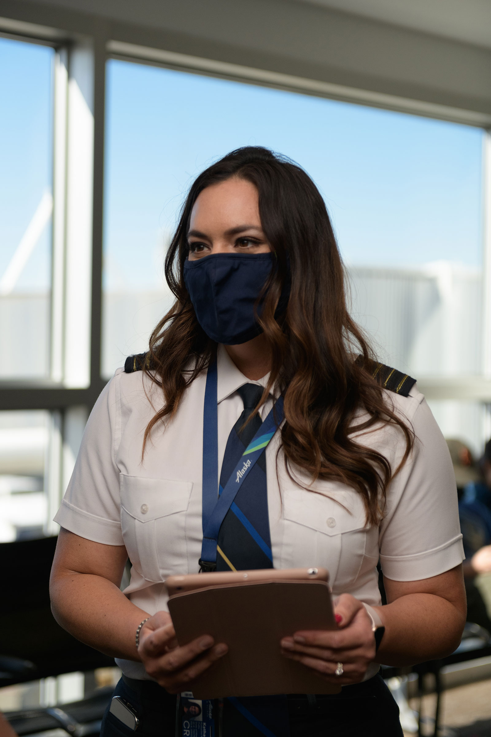 Alaska Airlines Captain Kat Pullis with the iPad containing the kind of data pilots once had to cart around in heavy suitcases filled with paper.