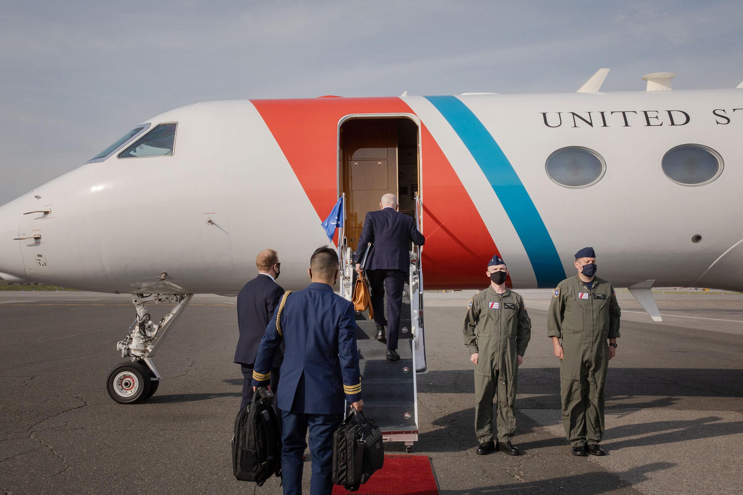 Mayorkas boards a plane at La Guardia Airport to return to Washington, DC.