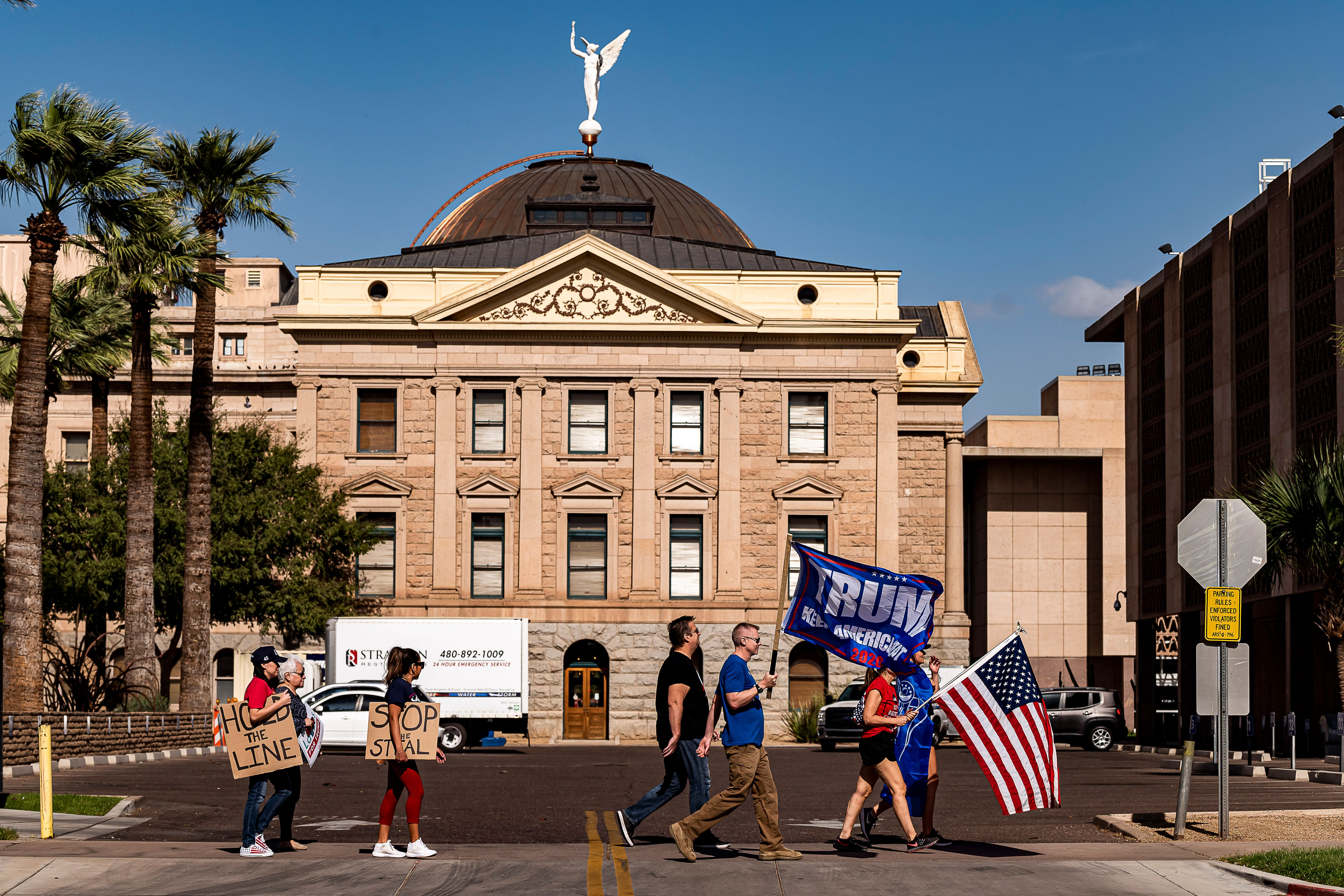 Supporters of former President Donald Trump protest in front of the Arizona State Capitol in Phoenix, Arizona, on November 7, 2020.