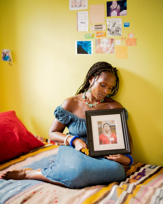 Dionne Monsanto holds a portrait of her daughter, Siwe, in the girl's bedroom in New York City, on Sept. 9, 2020. Siwe, 15, died by suicide in 2011.