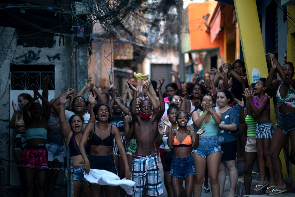 Residentes protest after a police operation against alleged drug traffickers at the Jacarezinho favela in Rio de Janeiro, Brazil, on May 06, 2021.