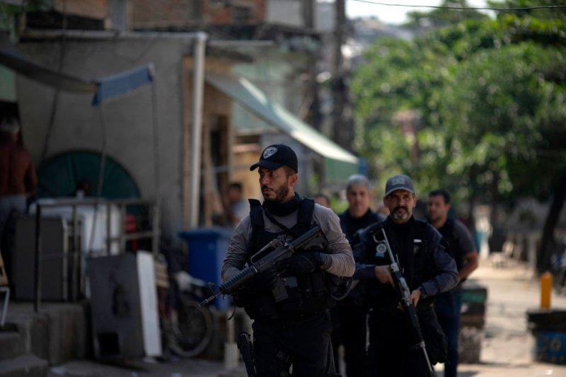 Civil Police officers take part in an operation against alleged drug traffickers at the Jacarezinho favela in Rio de Janeiro, Brazil, on May 06, 2021.