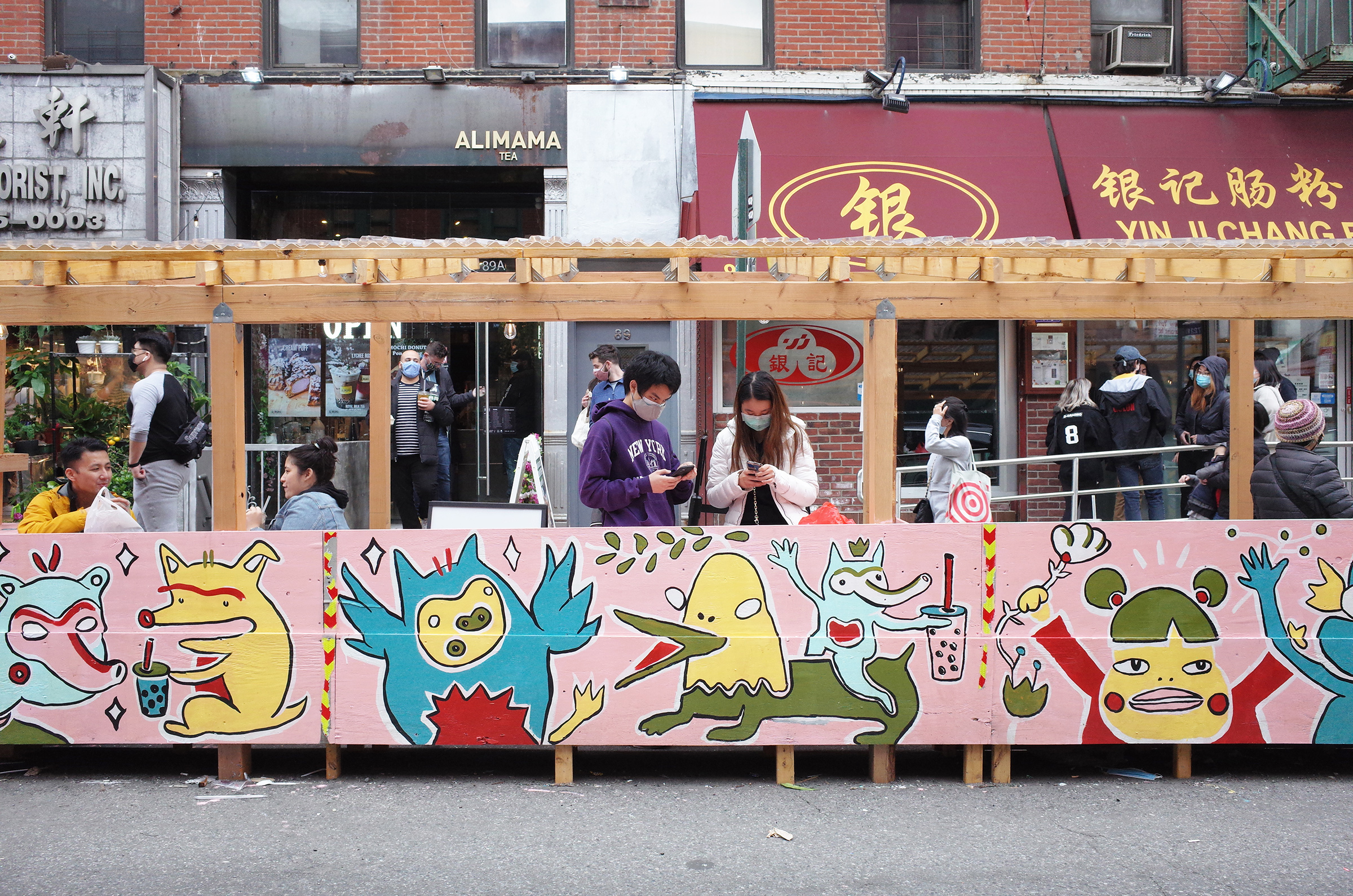 Chanel Miller's illustrative artwork on the corner of Bayard and Mulberry Streets in Chinatown, New York on April 17