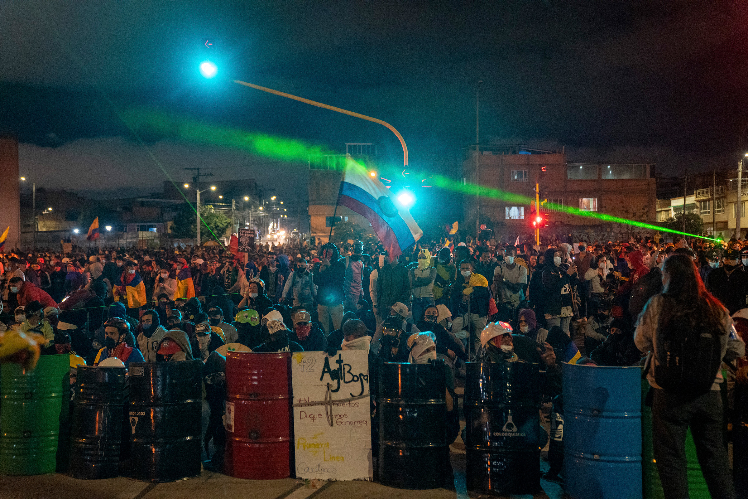 Demonstrators gather on a street in Bogota on May 12. Demonstrations that began two weeks ago as anger over pandemic-related tax reforms have intensified and spread, turning into a collective howl of outrage over abuses by the national police force.
