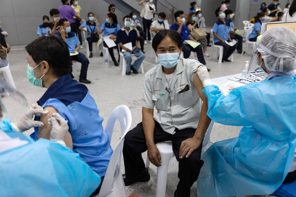 People receive doses of the Sinovac Covid-19 vaccine at a vaccination center set up at the Bang Sue Grand Station rail hub in Bangkok, Thailand, on Wednesday, May 26, 2021. It could take another five years before tourism revives fully in Thailand -- which closed its borders to most foreign visitors in March 2020 -- an ominous sign for one of the most travel-dependent economies in the world.