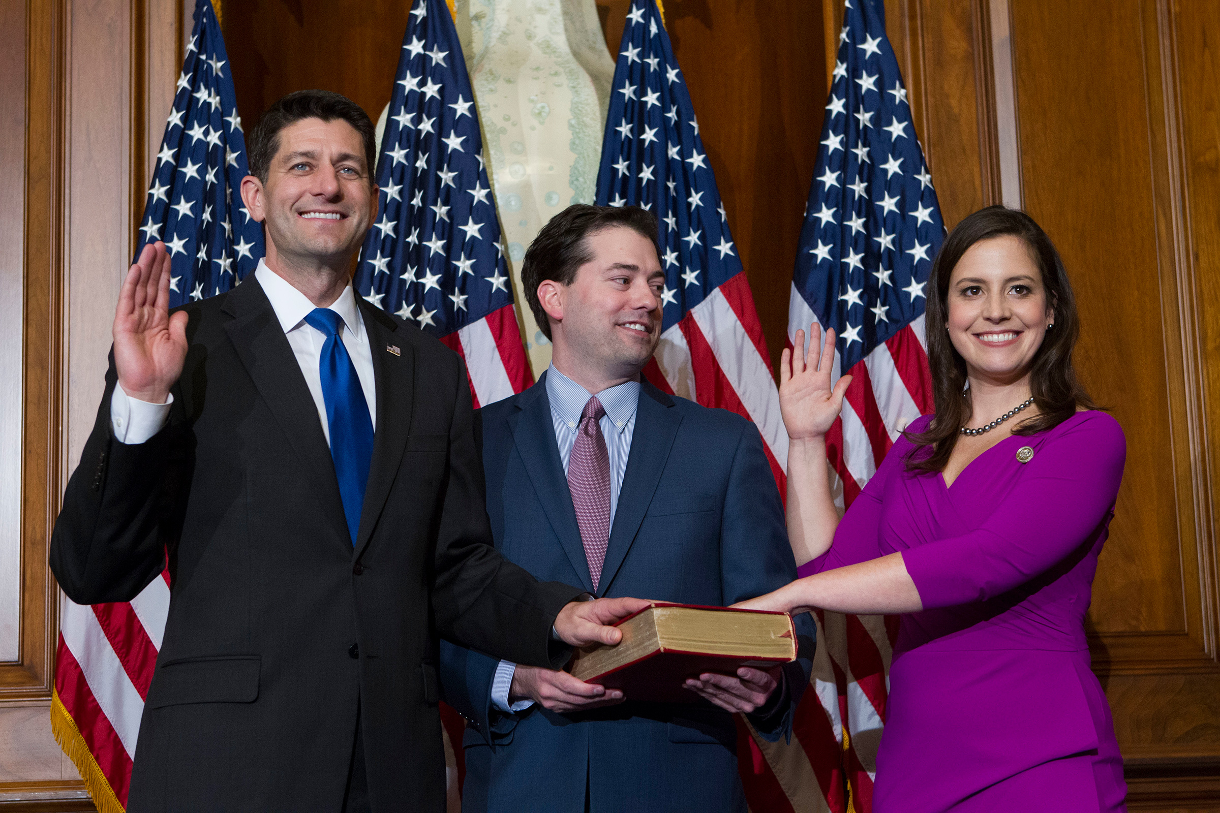 Former House Speaker Paul Ryan administers the House oath of office to Elise Stefanik during a mock swearing in ceremony on Capitol Hill in Washington, Jan. 3, 2017, as the 115th Congress began.