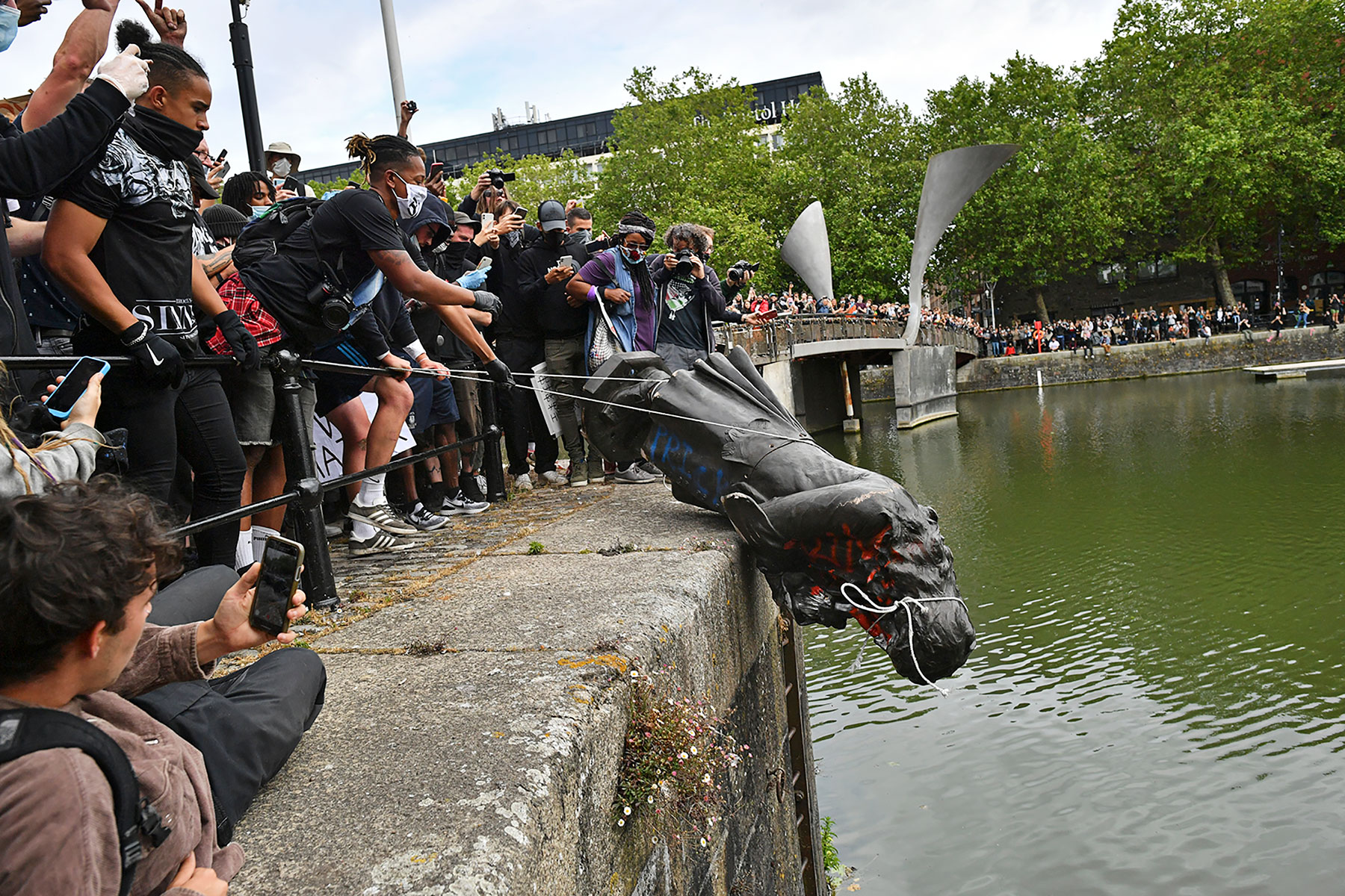 The statue of Edward Colston is thrown into the harbor of Bristol in southwest England, June 7, 2020.