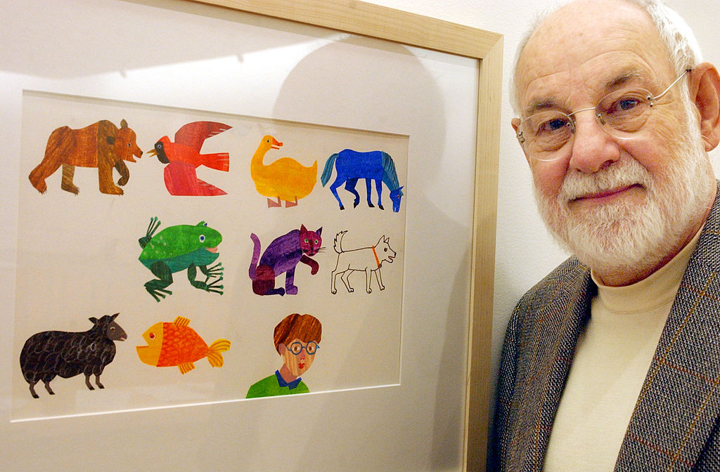 Artist Eric Carle, an illustrator and author of children's books, with his work from the book, The Mixed Up Chameleon. Carle died at age 91, it was announced Wednesday, May 27, 2021.