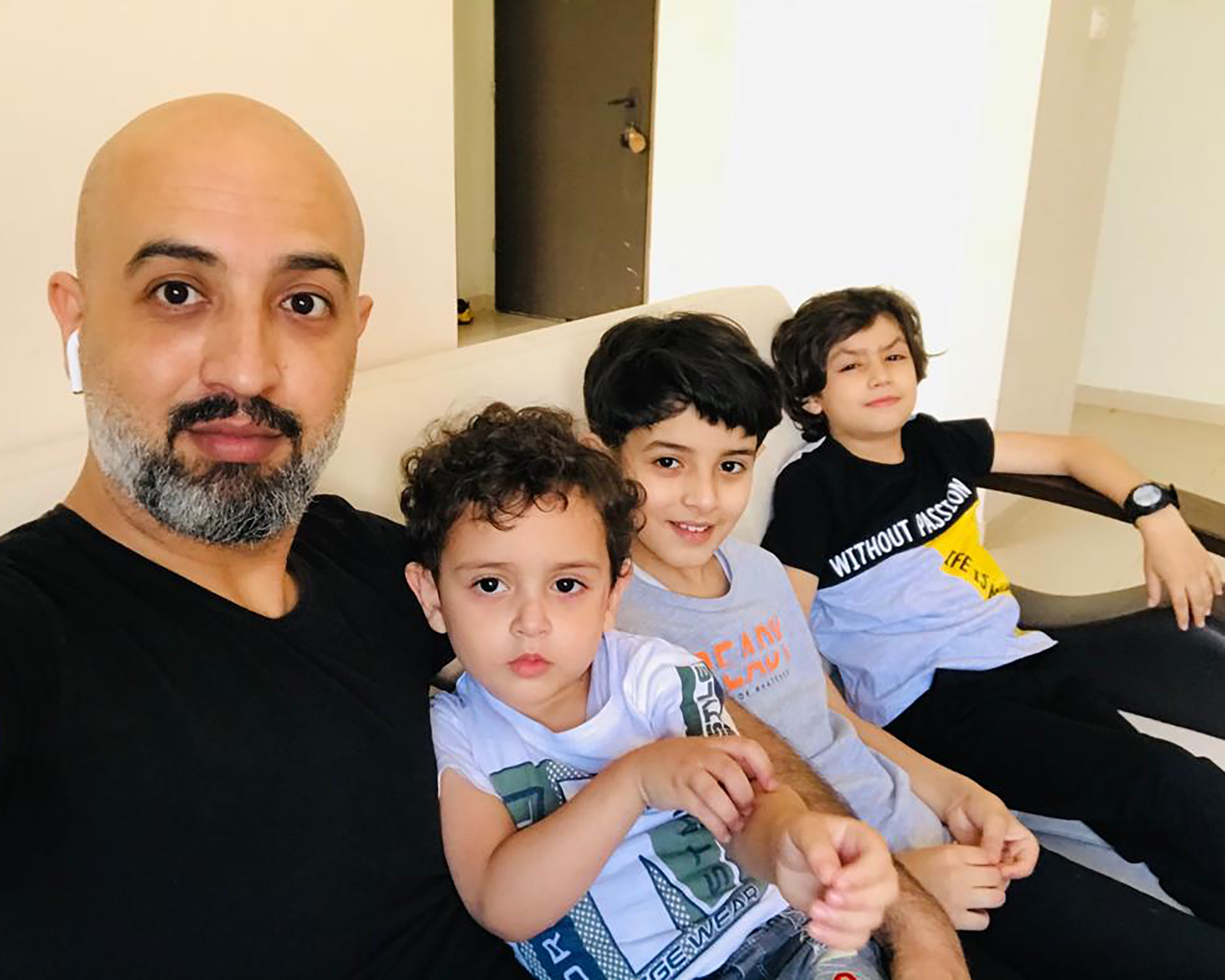The author with his three sons in Gaza.
