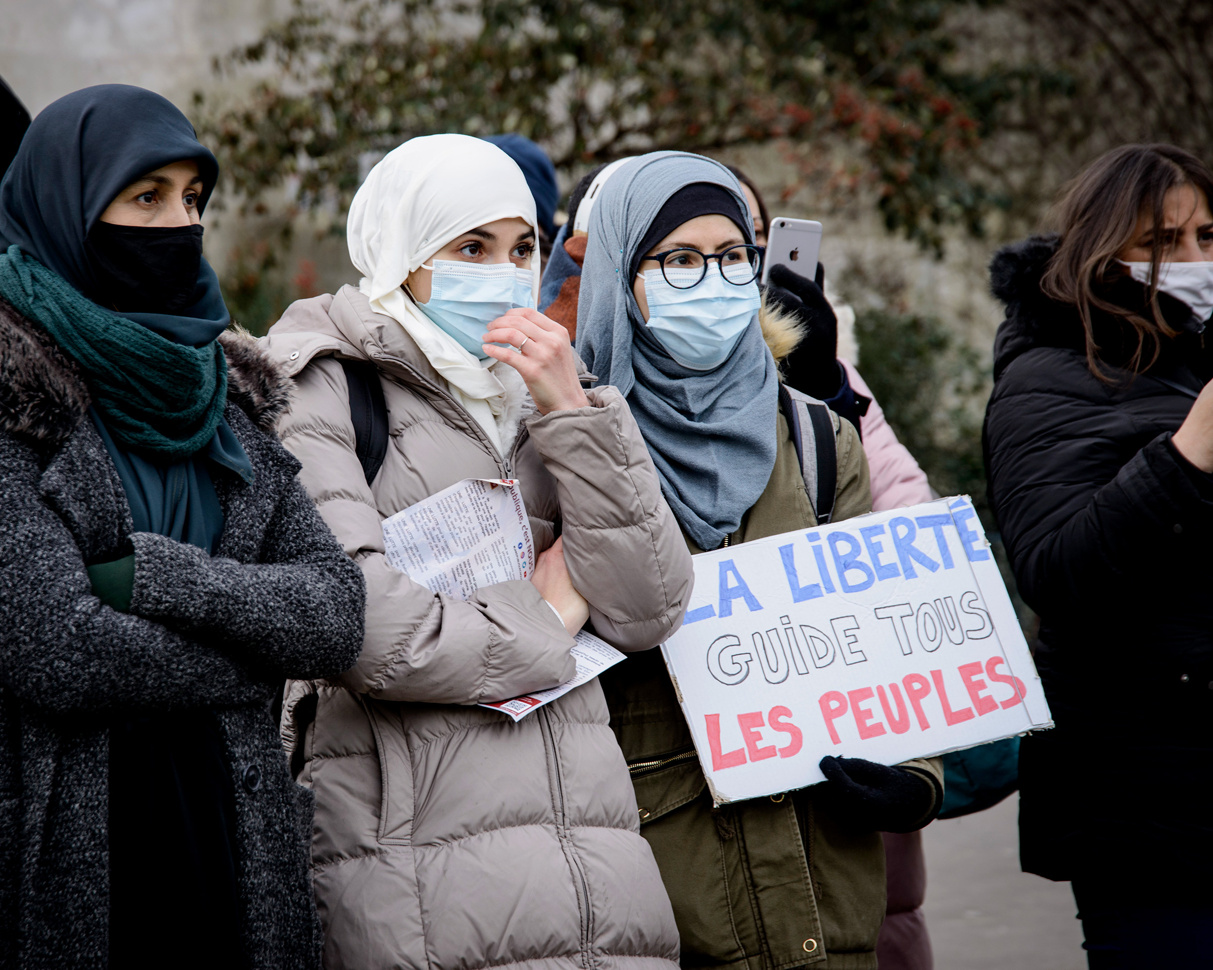 Demonstrators wearing hijab protest against the bill on separatism in Paris, on Feb. 14, 2021.